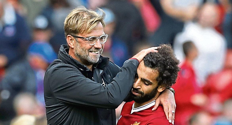 Liverpool manager Jurgen Klopp celebrates with Mohamed Salah (Martin Rickett/PA Wire)