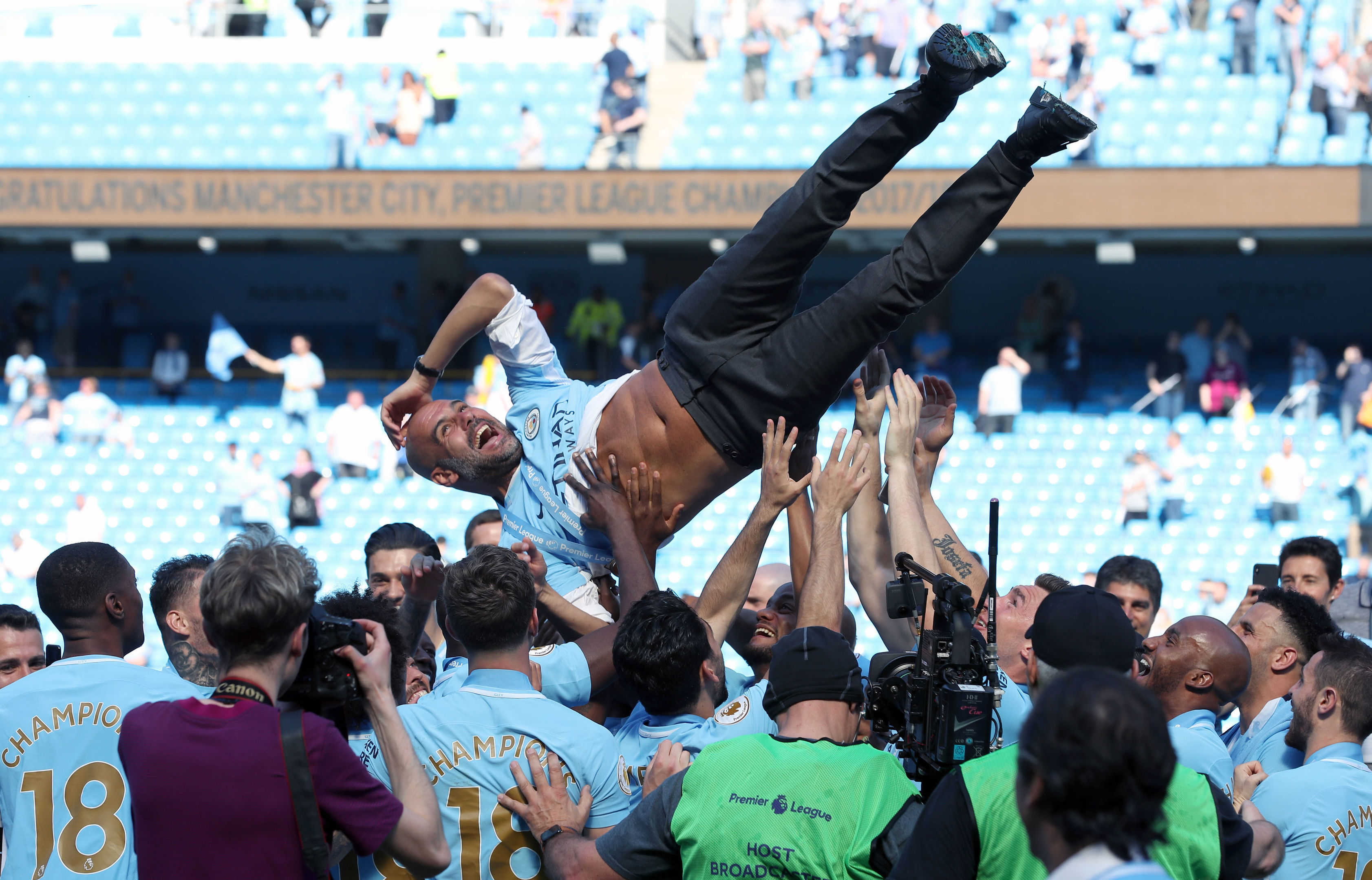 Manchester City manager Pep Guardiola is thrown up into the air by players during the Premier League trophy celebrations (Martin Rickett/PA Wire)