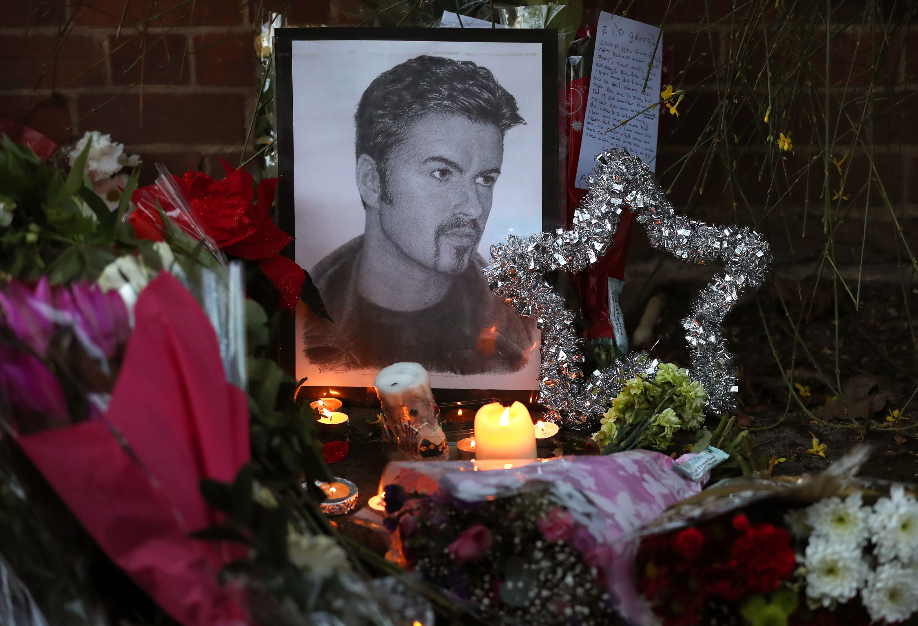 Tributes outside the Goring house of George Michael in Oxfordshire (Andrew Matthews/PA Wire)