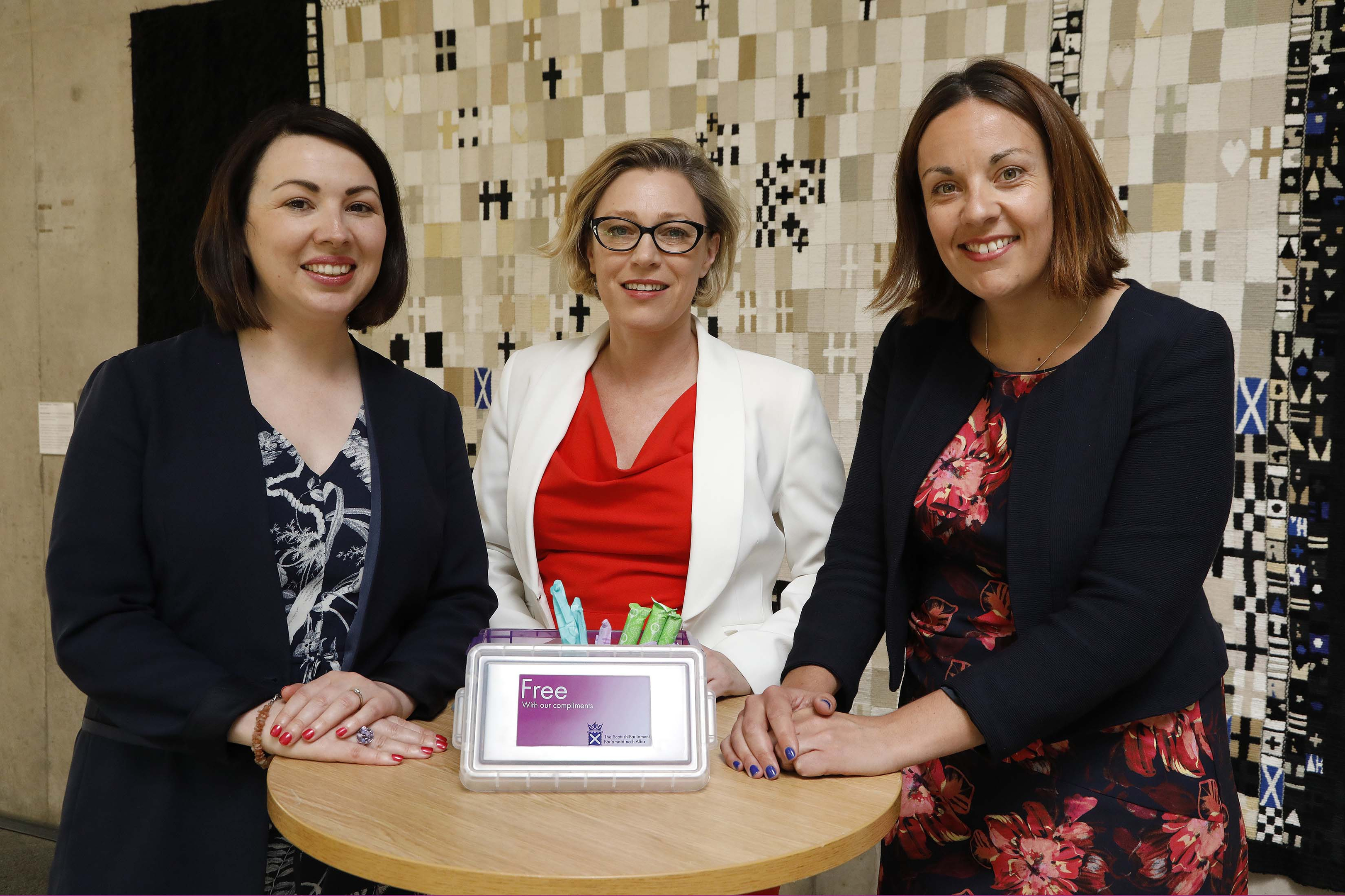 Monica Lennon MSP, Gillian Martin MSP and Kezia Dugdale MSP at the launch the free sanitary products for women initiative at the Scottish Parliament (Andrew Cowan/Scottish Parliament/PA Wire)