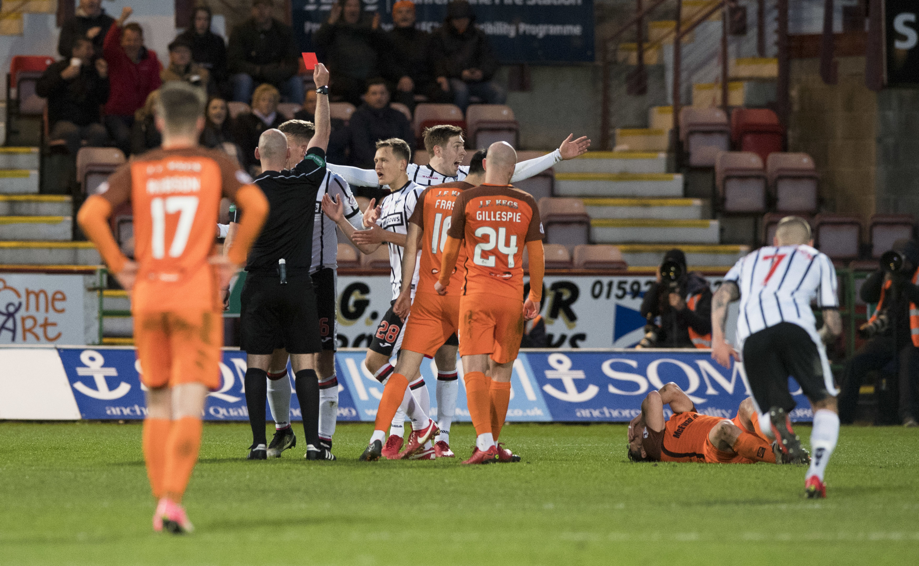 Dunfermline's Lee Ashcroft is sent off by referee Bobby Madden (centre) after a foul on Dundee United's Scott McDonald (R) (SNS Group / Alan Harvey)