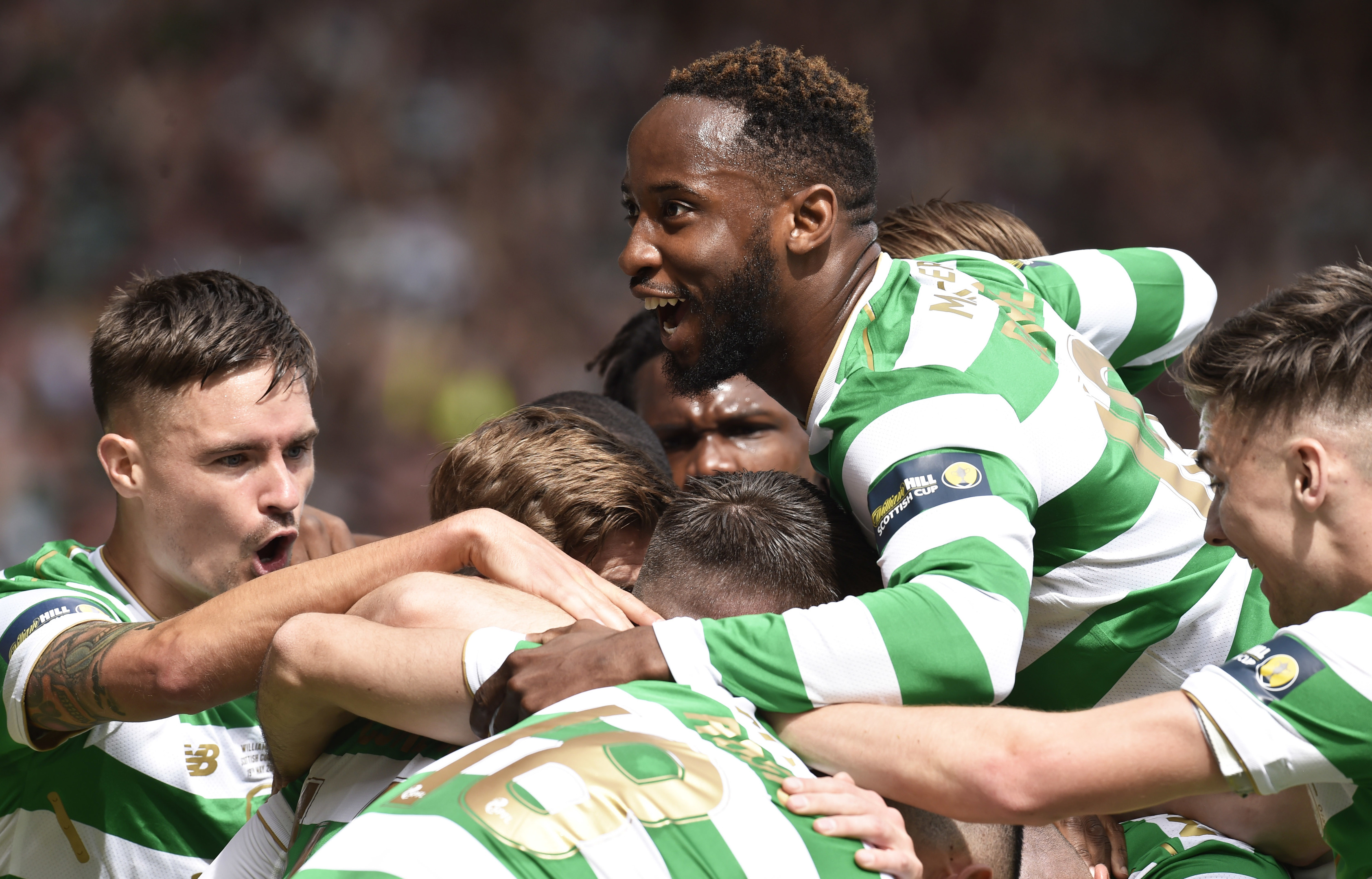 Celtic's Moussa Dembele celebrates with teammates after Callum McGregor makes it 1-0 (SNS Group / Rob Casey)