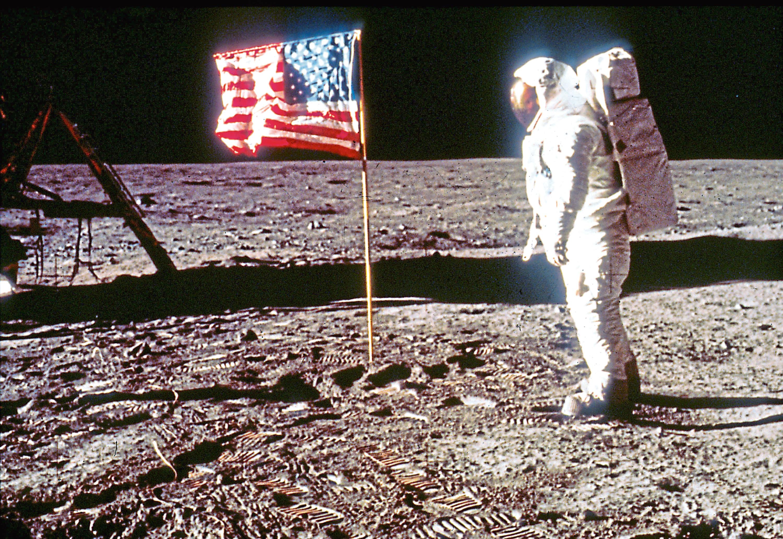 "Astronaut Edwin ""Buzz"" Aldrin poses next to the U.S. flag July 20, 1969 on the moon (NASA/Liaison)"
