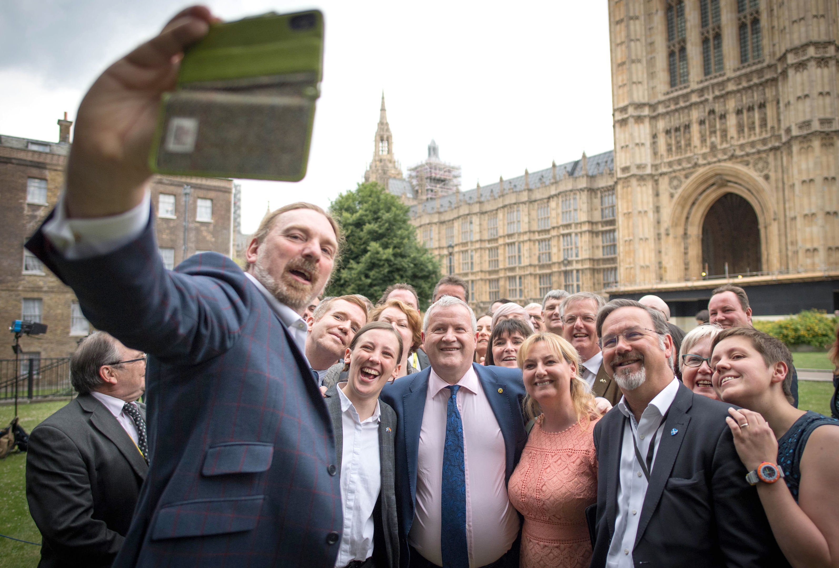 MP Chris Law takes a selfie alongside SNP Westminster leader Ian Blackford (centre), surrounded by the party's MPs following the walk-out (Stefan Rousseau/PA Wire)