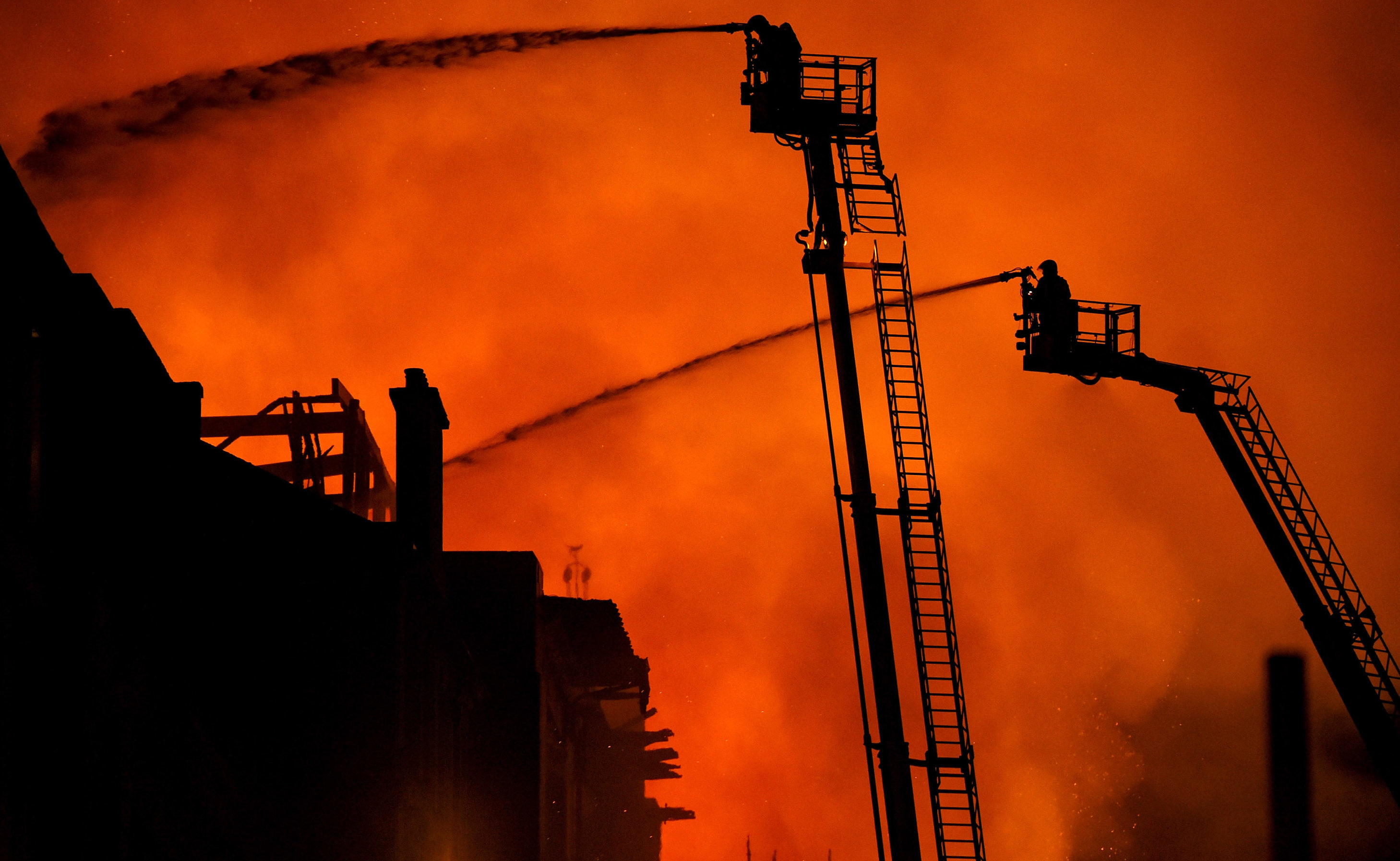 Fire fighters battle a blaze at the Mackintosh Building.