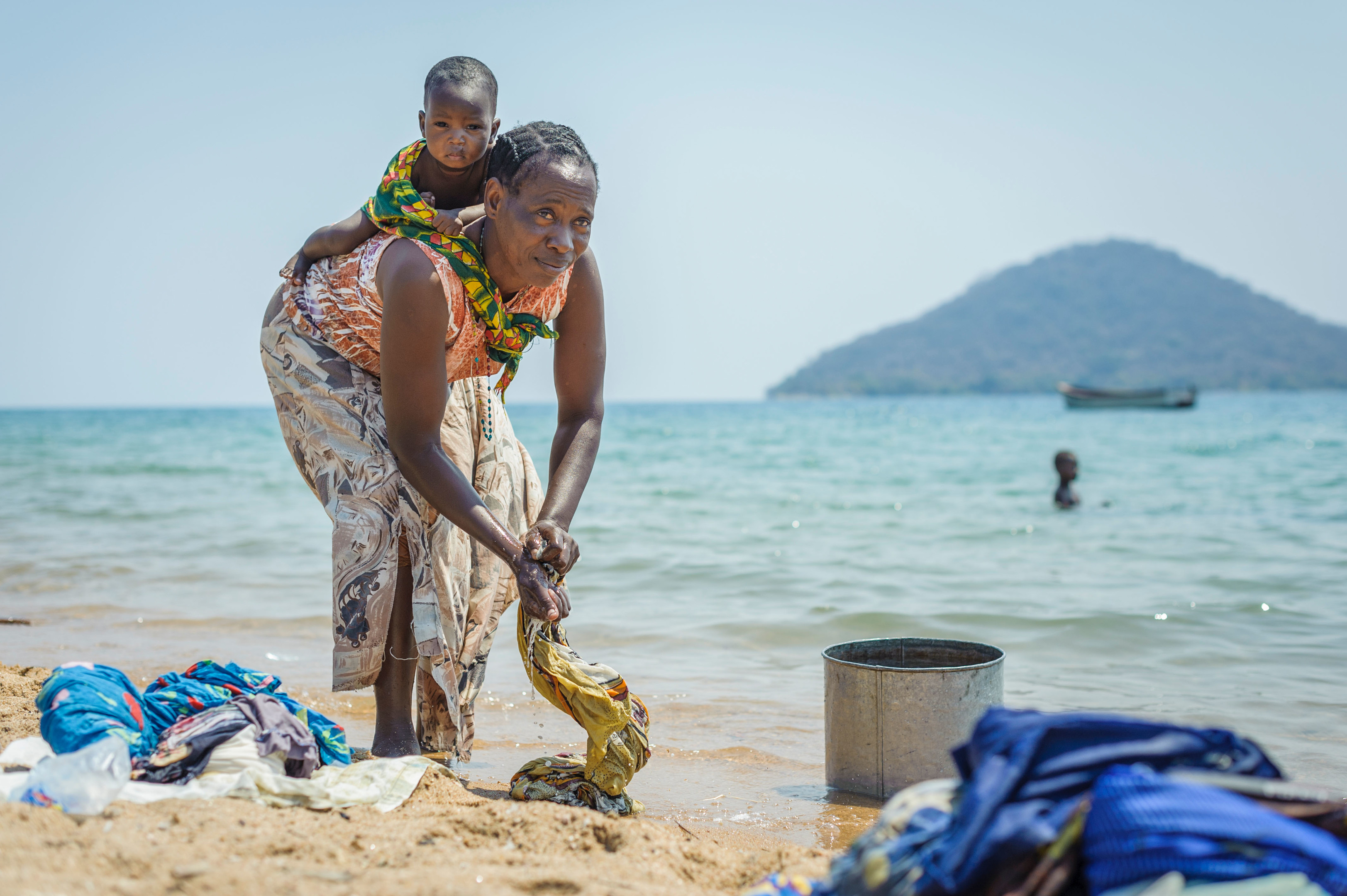 A woman washes clothes in Malawi where concern was raised about projects backed by Scots ministers (Alamy)