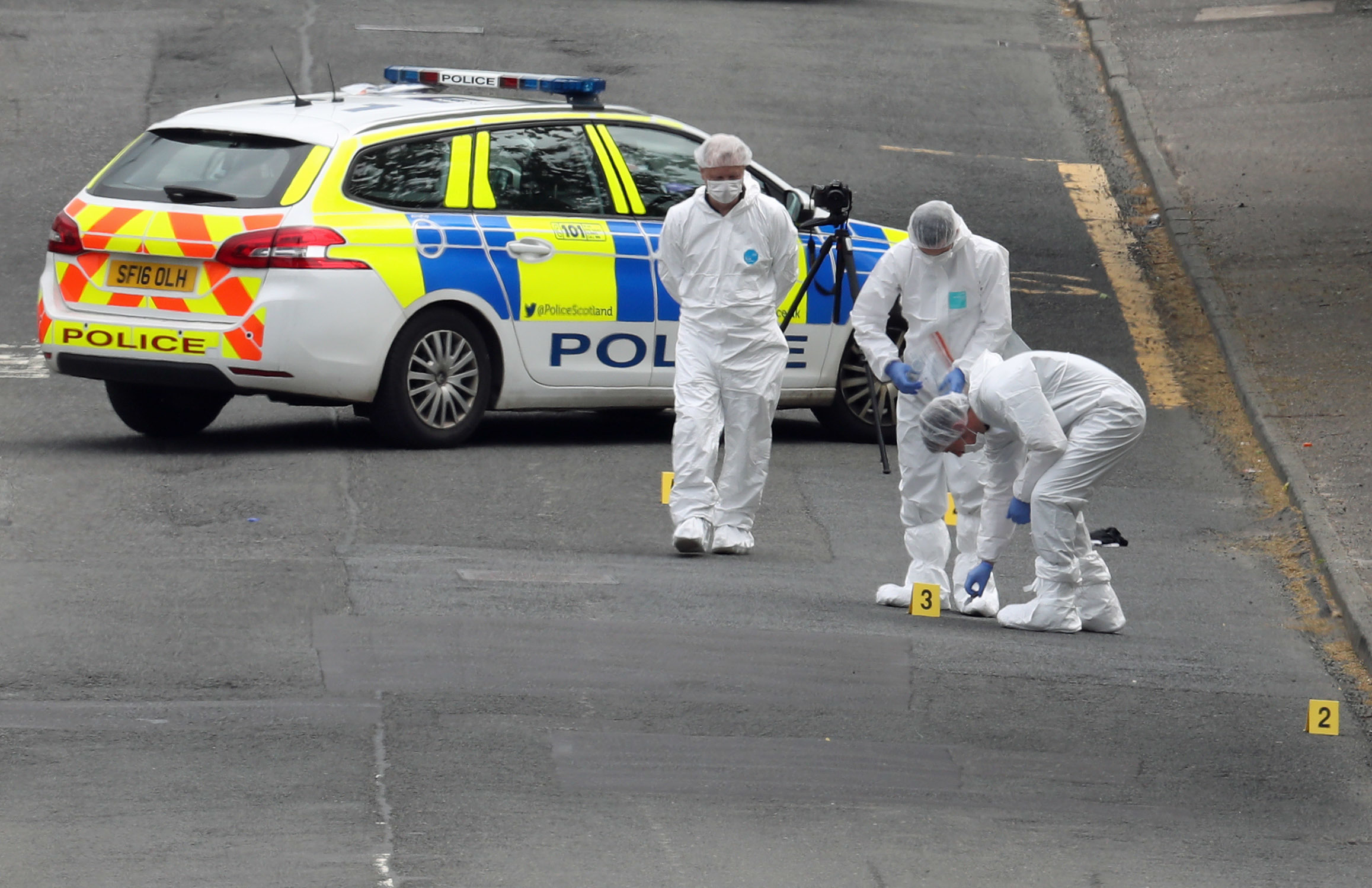 Forensic officers investigate the scene of an incident in Gateside Gardens, Greenock (Andrew Milligan/PA Wire)