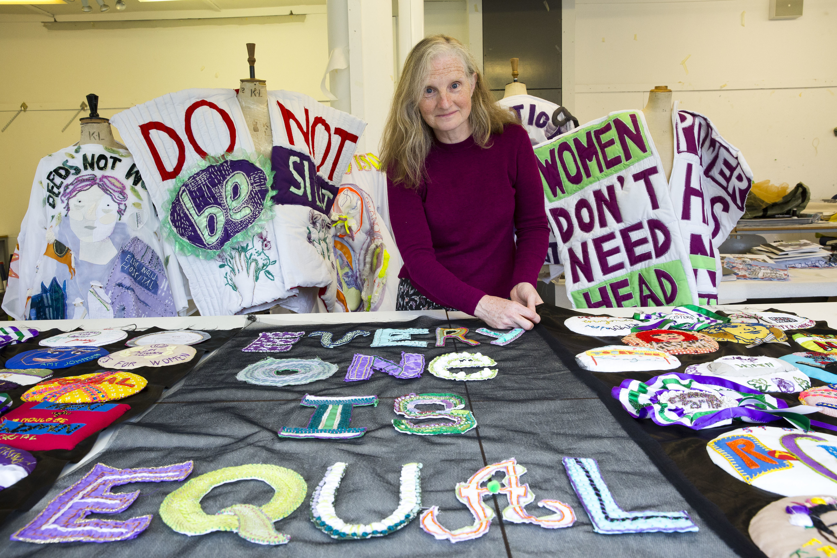 Lindy Richardson of Edinburgh Arts College with suffragettes textiles (Jamie Williamson)