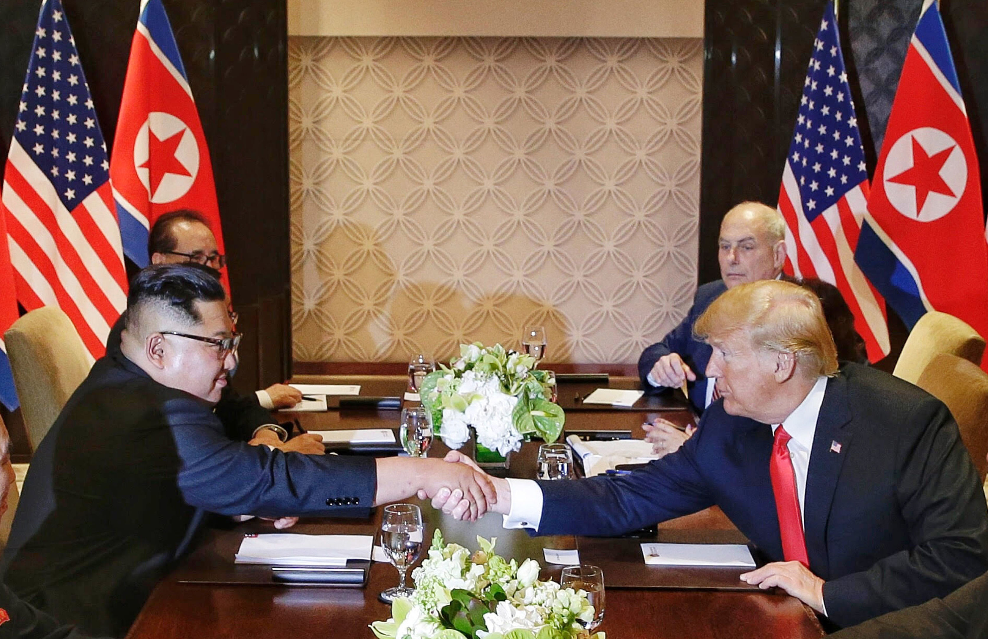U.S. President Donald Trump shakes hands with North Korean leader Kim Jong Un during their meeting (Kevin Lim/The Straits Times via AP)