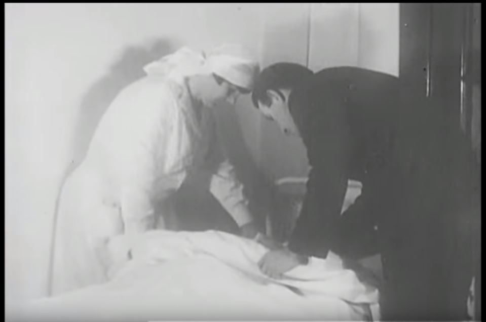 Skye nurse Annie Mackinnon seen tending to a patient in a film produced to promote the Frontier Nursing Service