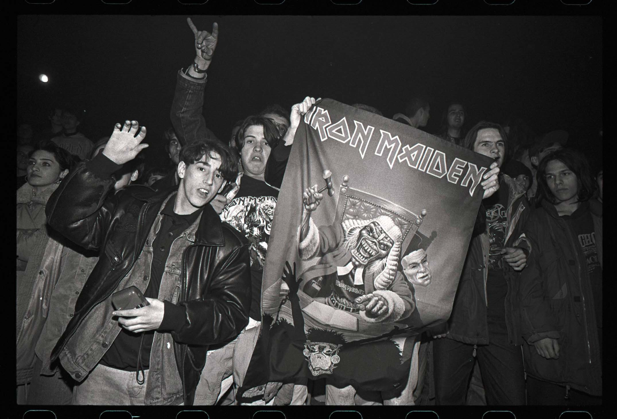 isbelieving but jubilant Iron Maiden fans in Sarajevo welcome Bruce Dickinson after the singer was smuggled through a warzone in 1994