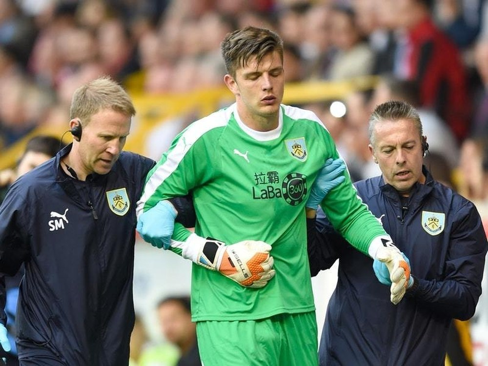 Burnley goalkeeper Nick Pope was escorted off the pitch injured at Pittodrie (PA Wires)