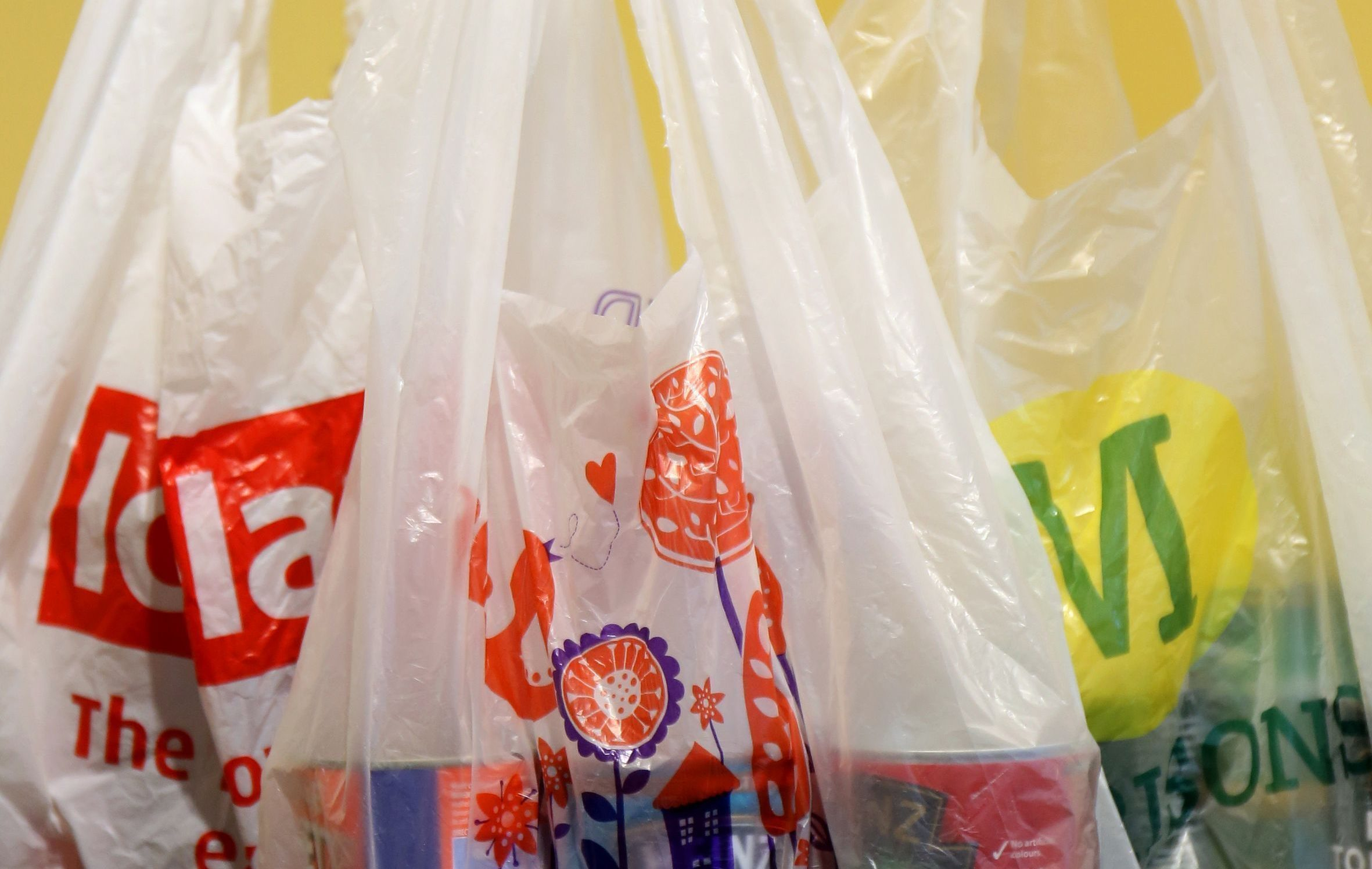 Campaigners are calling for charges for plastic bottles and disposable coffee cups after figures showed the 5p carrier bag levy had dramatically reduced use. (Chris Radburn/PA wire)