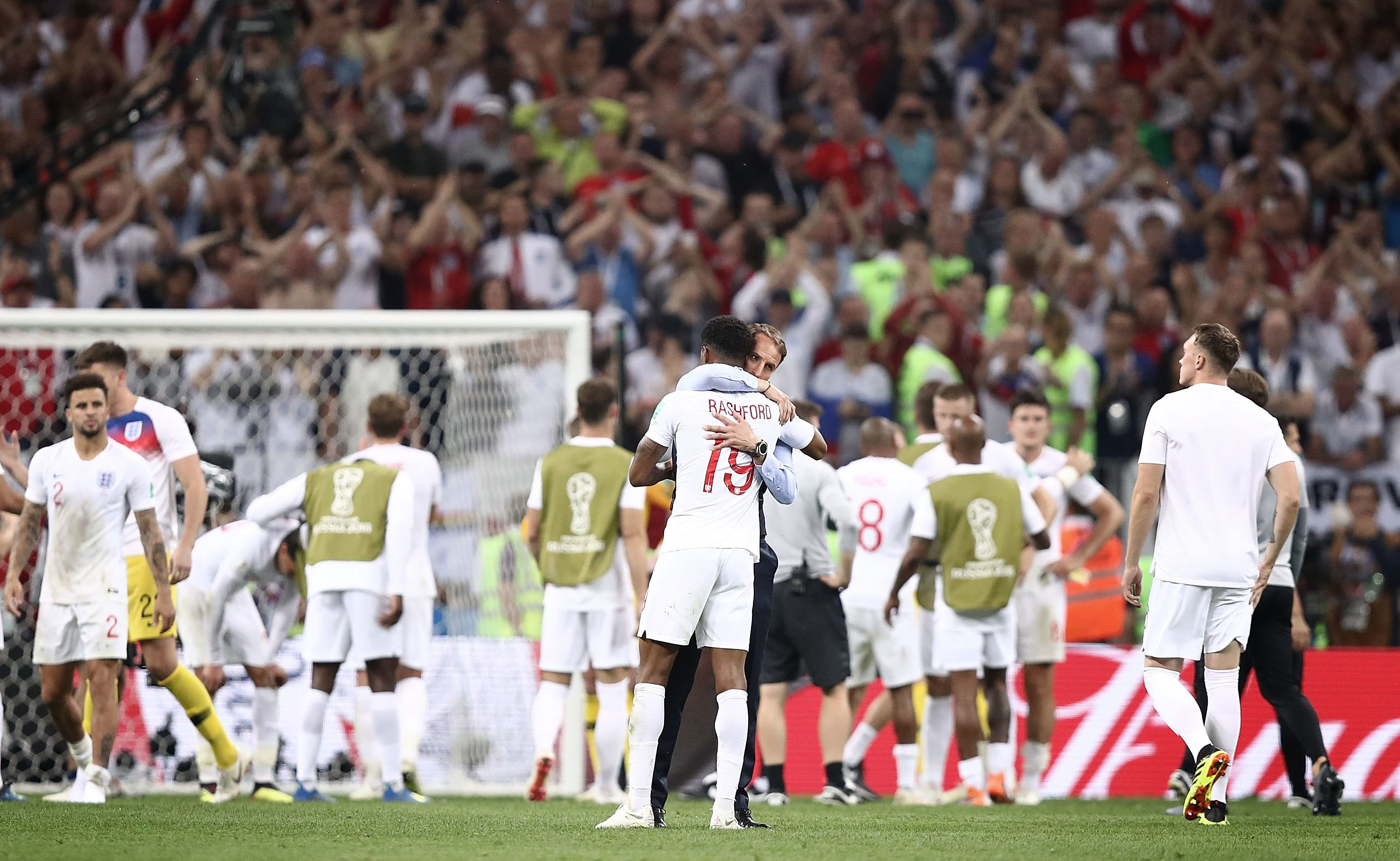 Gareth Southgate commiserates with Marcus Rashford as the England players come to terms with being knocked out of the World Cup (Ryan Pierse/Getty Images)