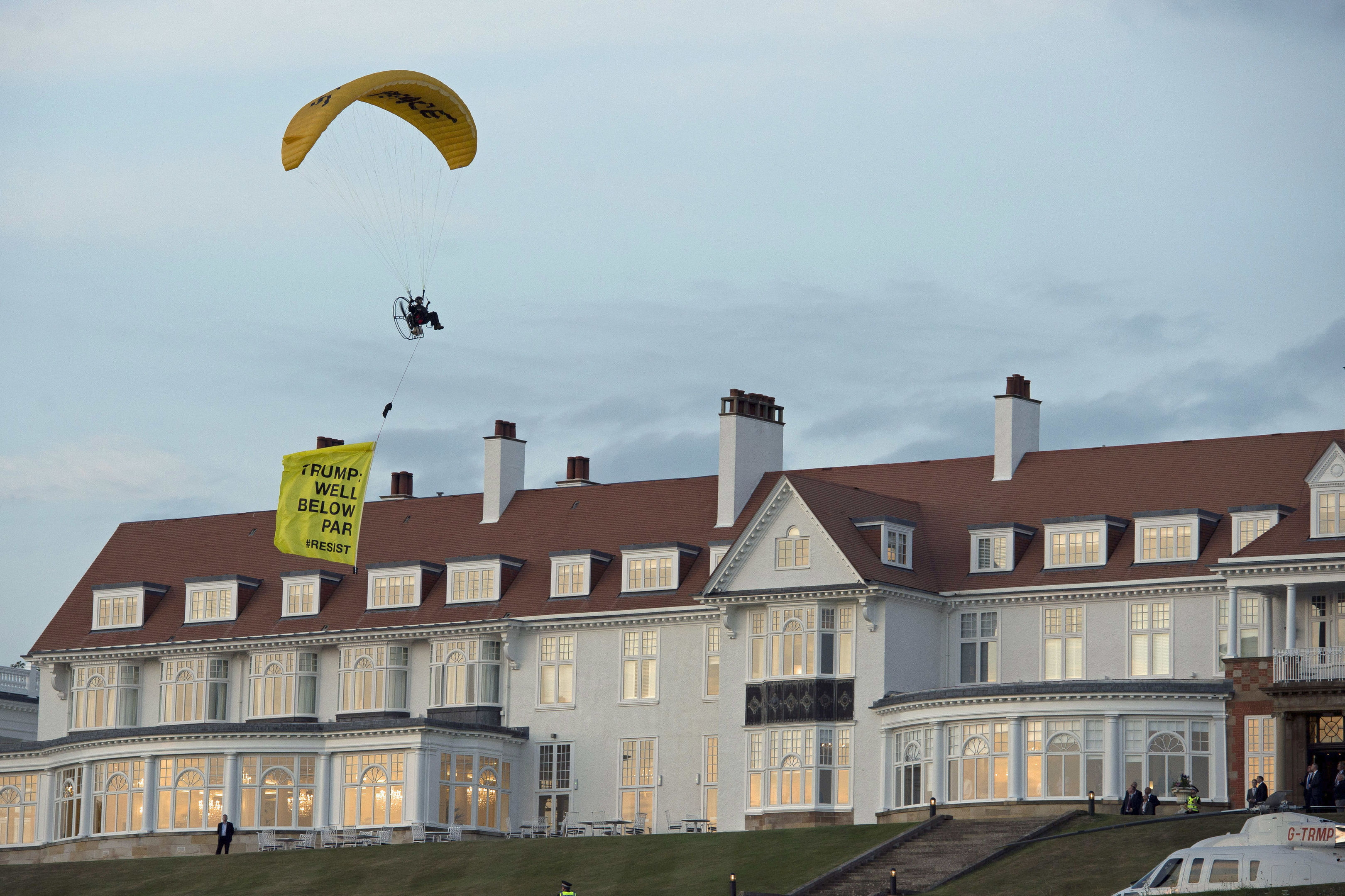 A paraglider trails a banner over Turnberry as Donald Trump arrives (John Linton / PA Wire)