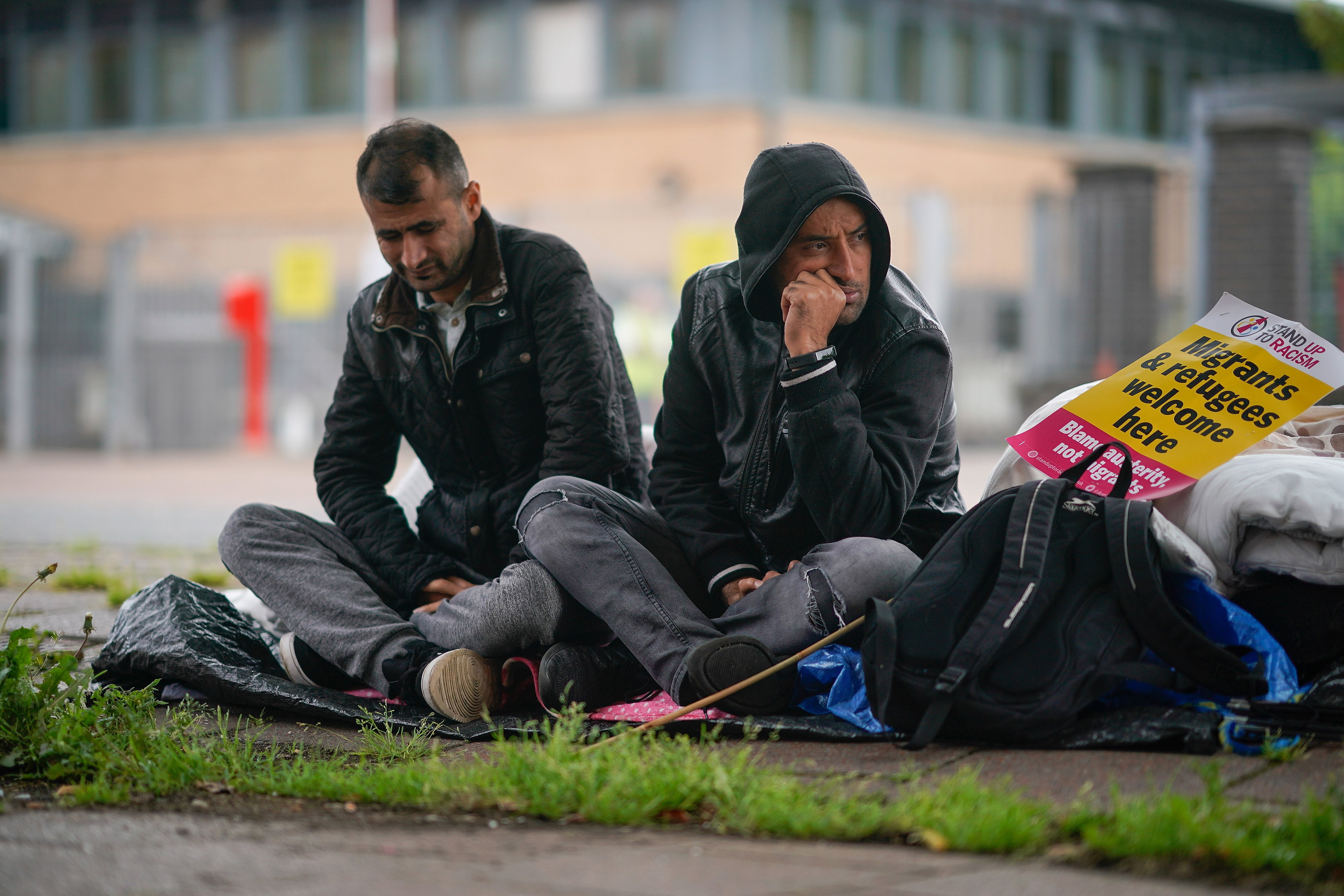 Afghan refugee Rahman Sahah (R) aged 32 and Mirwais Ahmadzai, 27, start their hunger strike outside the H.M. Government Home Office on August 1, 2018 in Glasgow, Scotland. Both men have requested asylum in the UK which has been refused. The two men are tenants of social housing provider Serco and face possible eviction.