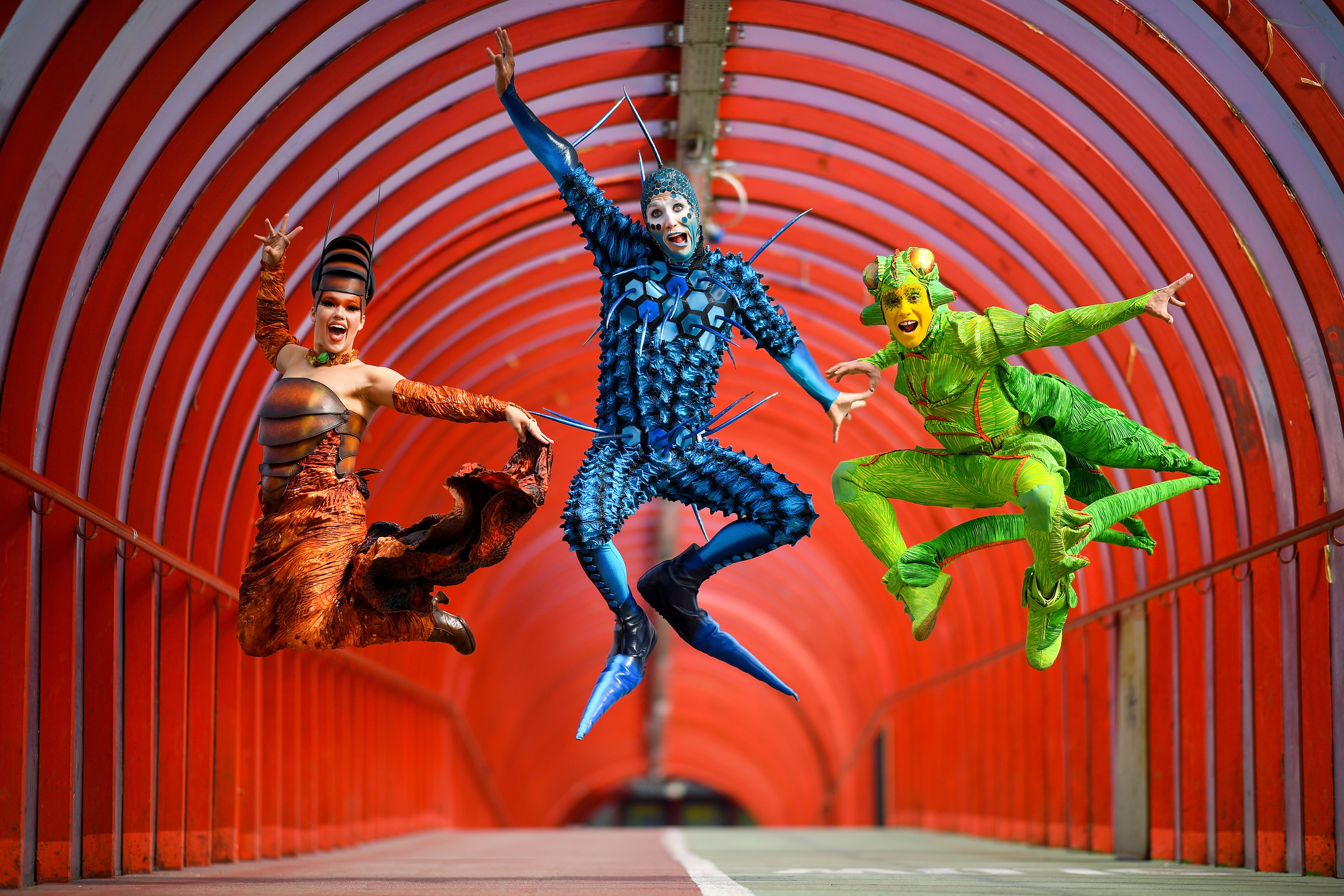 "Cirque du Soleil's Julia Tazie, Jan Duther and Nathan Rivera-Drydak perform in the ""Smartie Tube"" walkway in Glasgow (Jeff J Mitchell/Getty Images)"