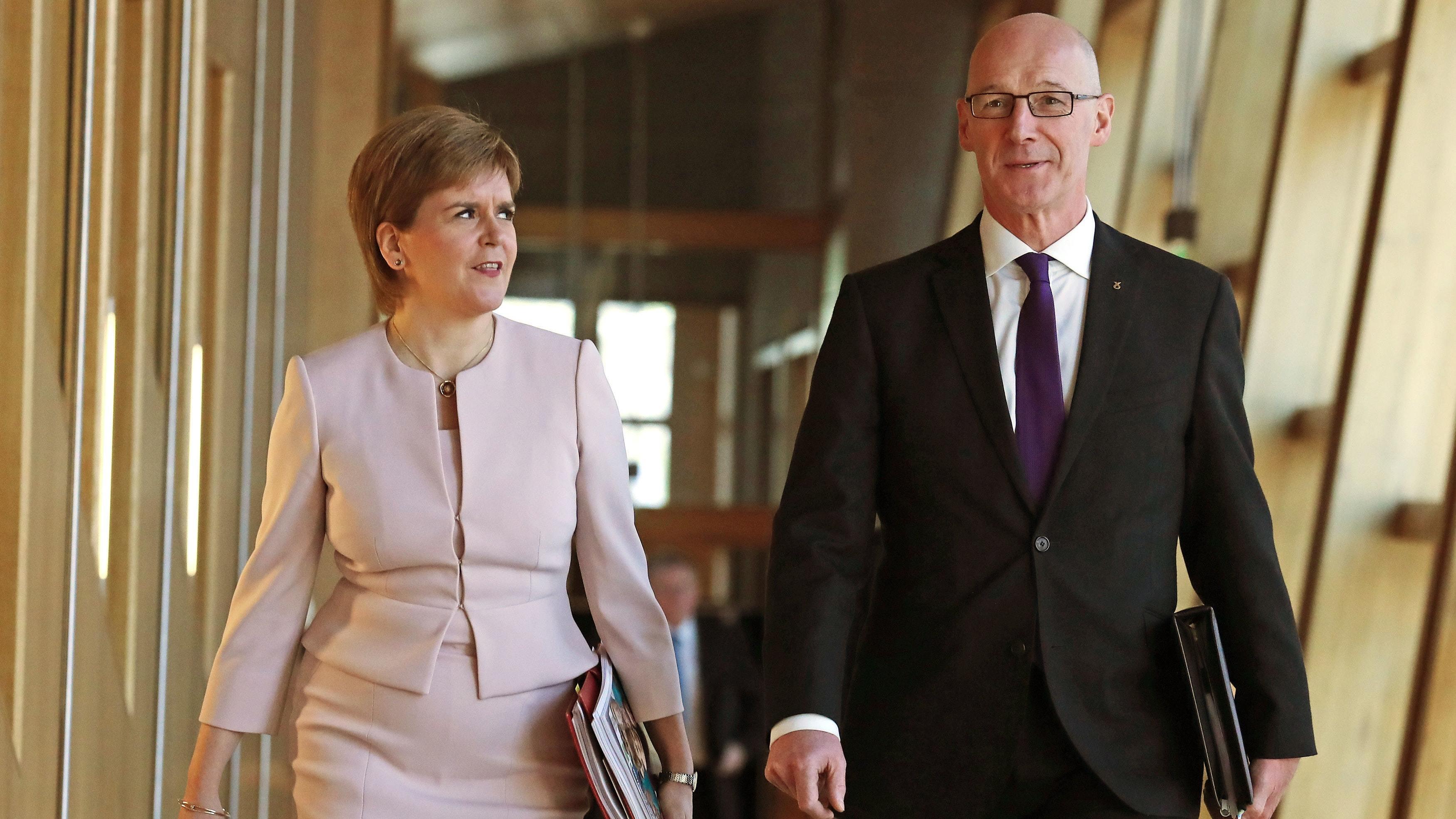 Nicola Sturgeon and John Swinney (PA)