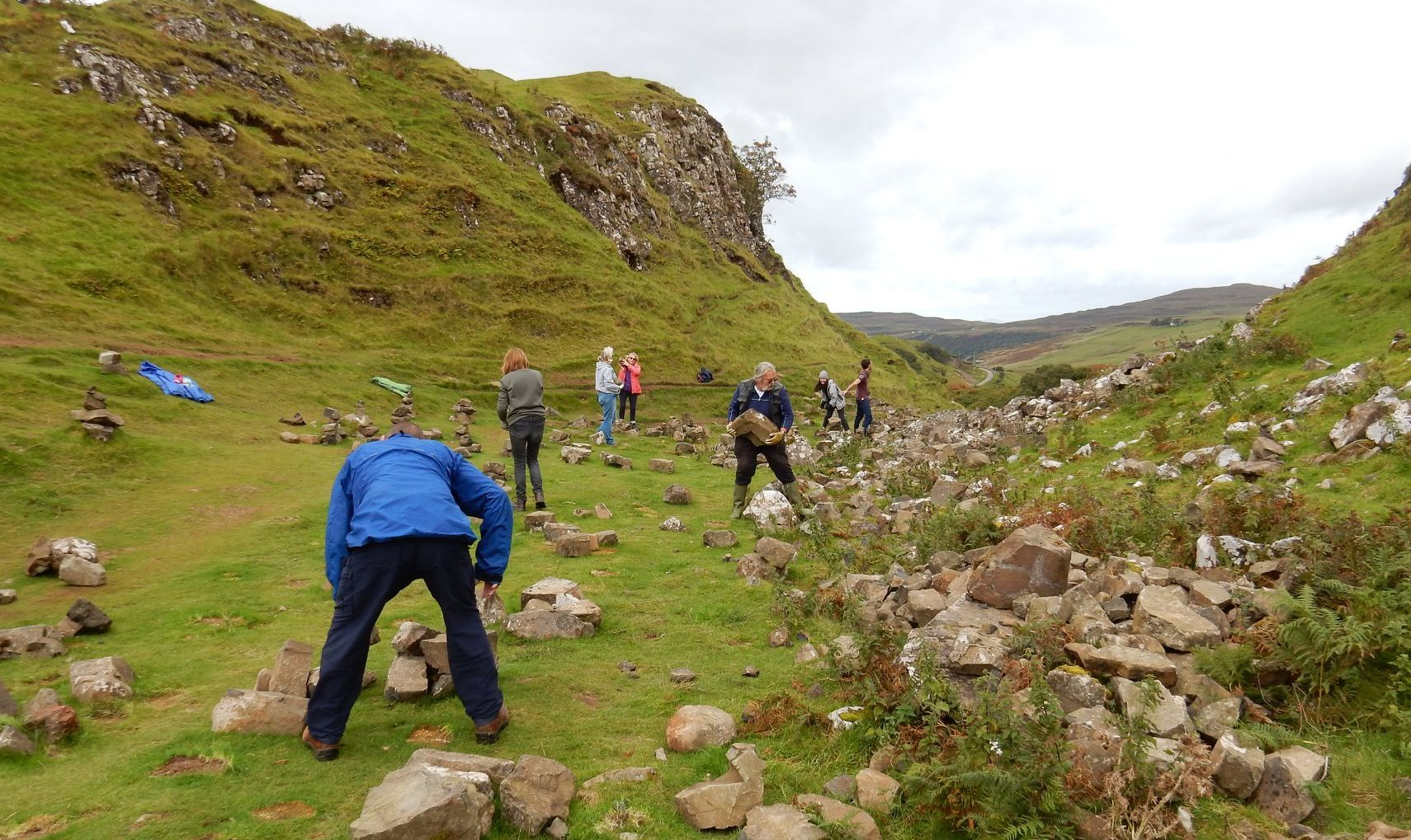 Locals removing the stone stacks left by tourists at the Fairy Glen, Isle of Skye. Staffin, Isle of Skye Facebook page.