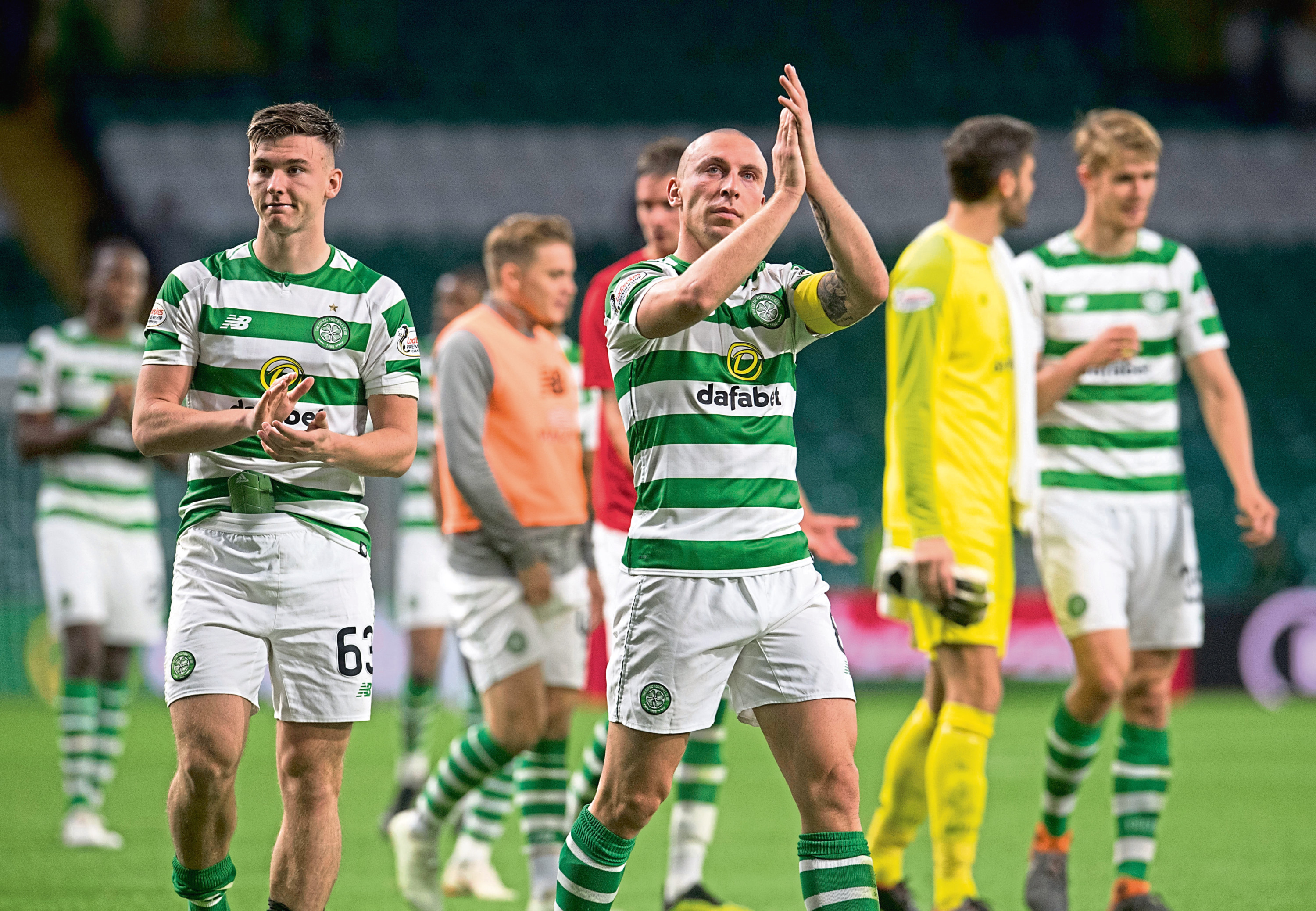 Celtic captain Scott Brown and Kieran Tierney applaud the fans at full time after win over Suduva (SNS Group)