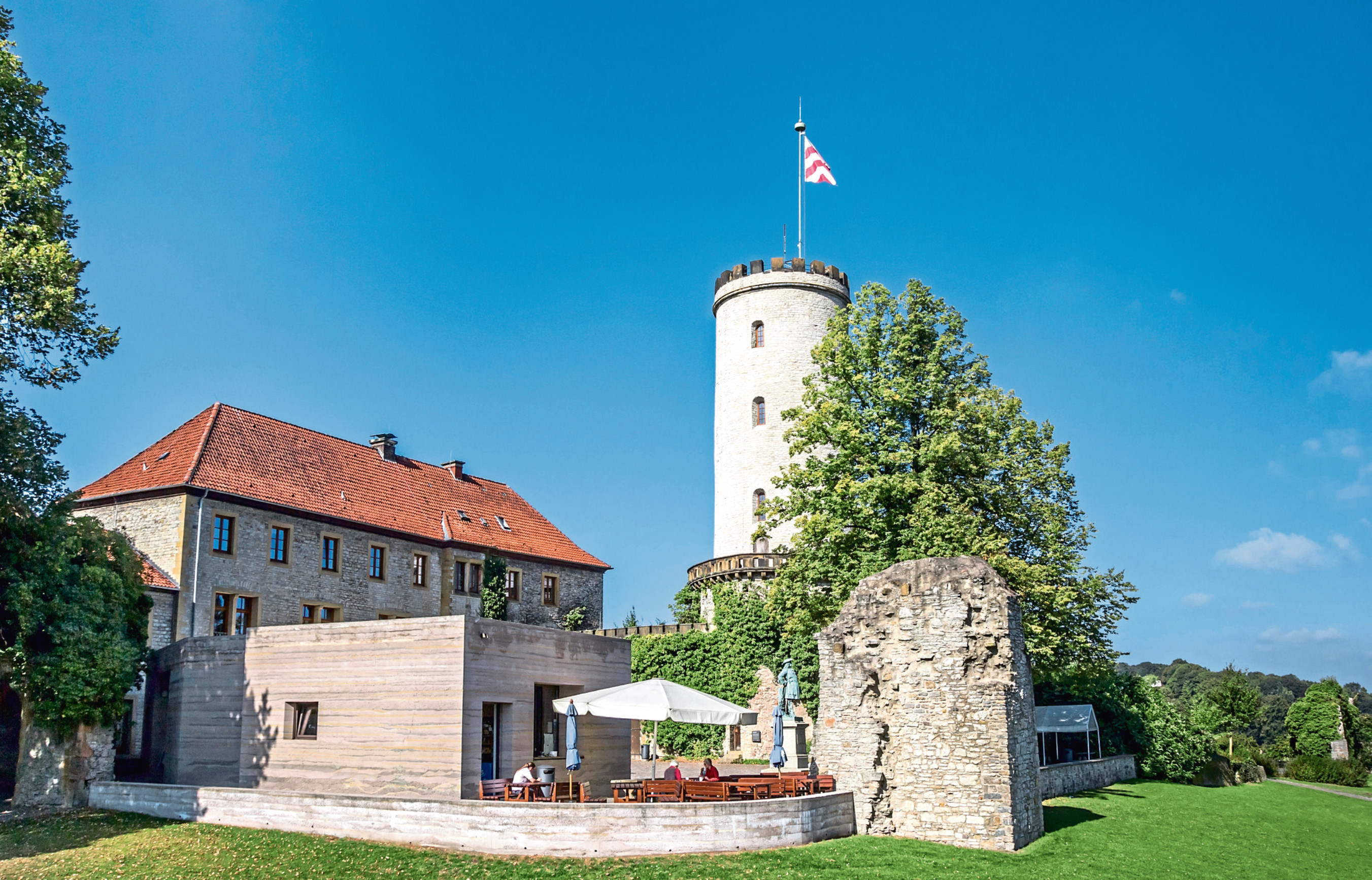 Visitors enjoy lunch at Sparrenburg Castle in Bielefeld. Or do they?