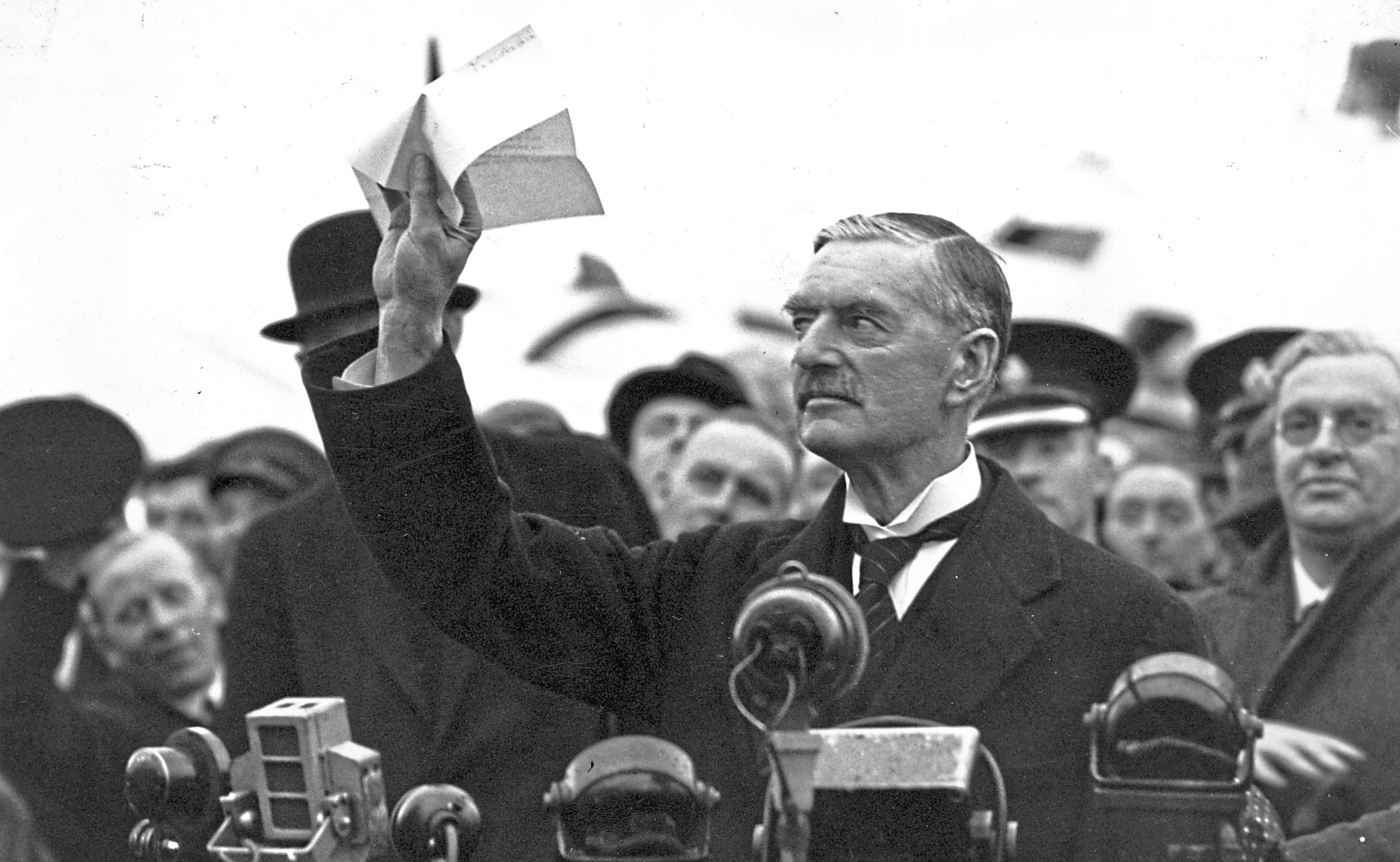 British statesman and prime minister Neville Chamberlain (1869 - 1940) at Heston Airport on his return from Munich after meeting with Hitler, making his 'peace in our time' address.   (Central Press/Getty Images)