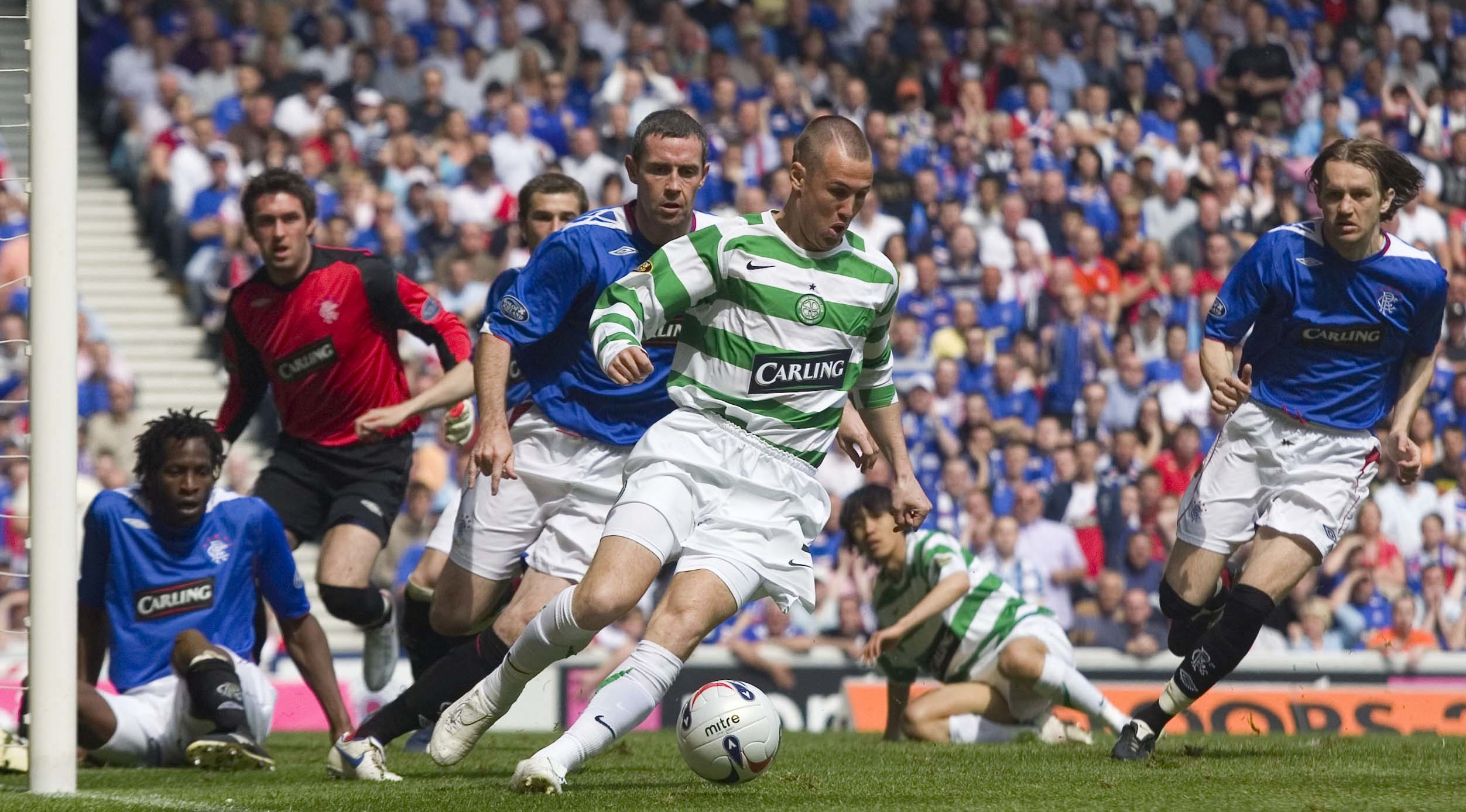 Kenny Miller in action for Celtic against Rangers' David Weir in 2007 (SNS Group / Aubrey Washington)
