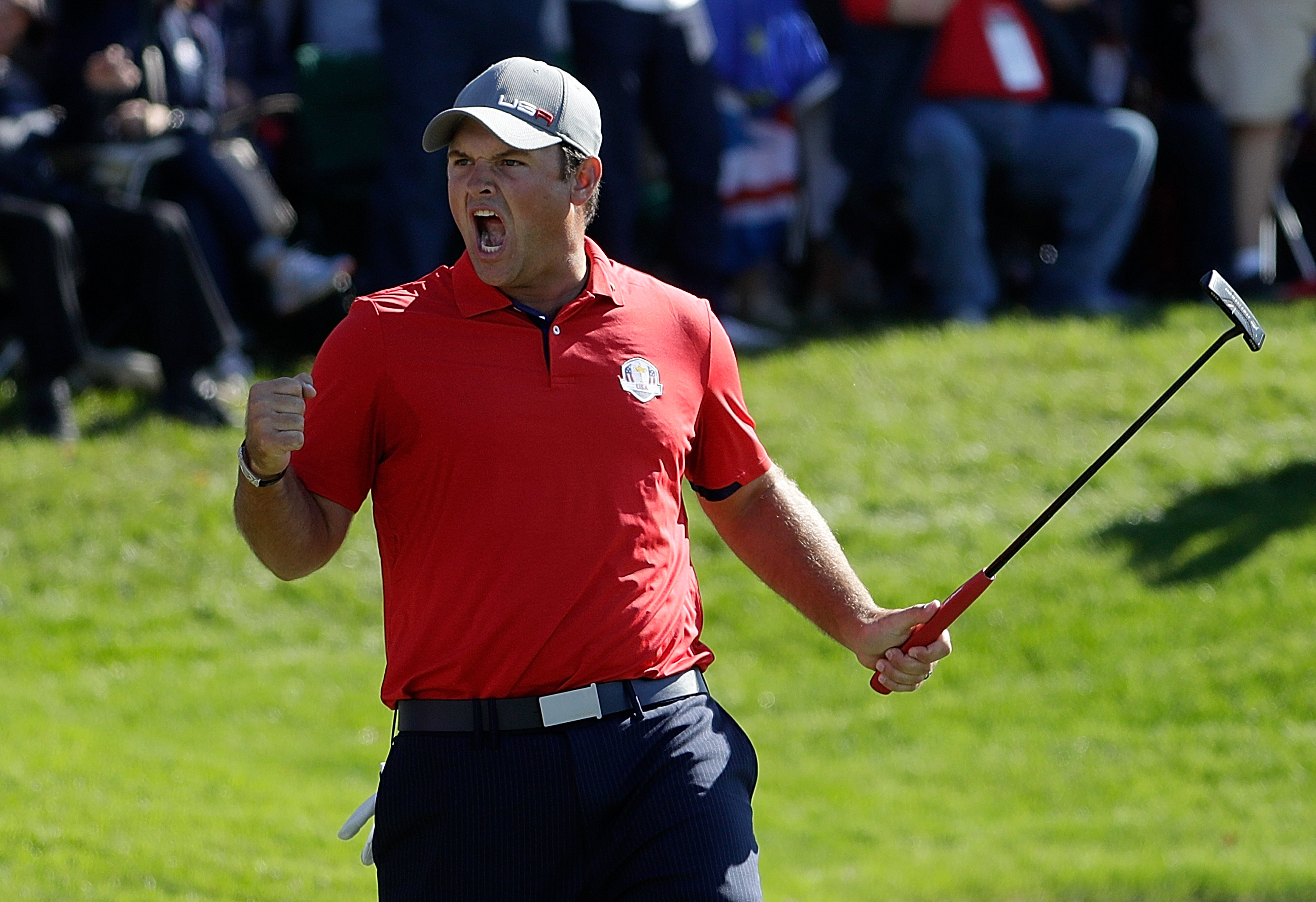 Patrick Reed celebrates his and Jordan Spieth's 3&2 opening- morning foursomes win over Henrik Stenson and Justin Rose at Hazeltine two years ago (Jamie Squire/Getty Images)