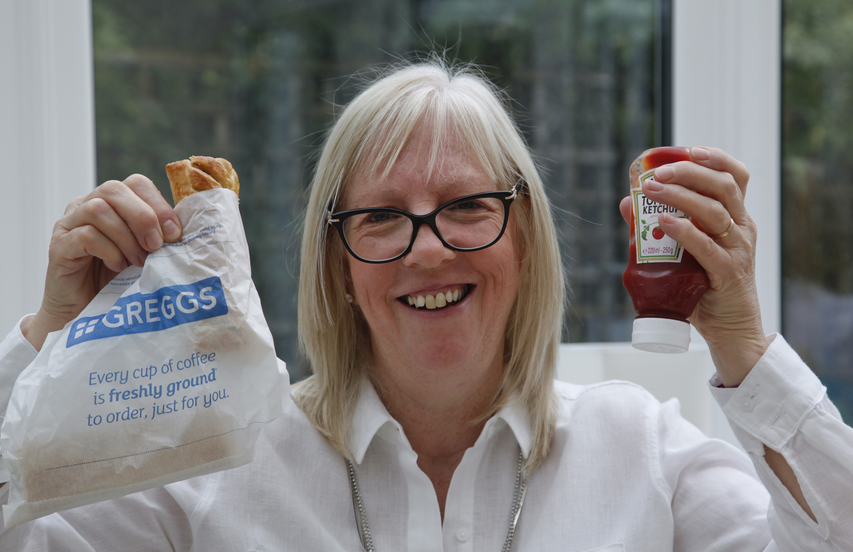 Nicola Wilson with a sausage roll and ketchup, her biggest craving during treatment (Alistair Linford)