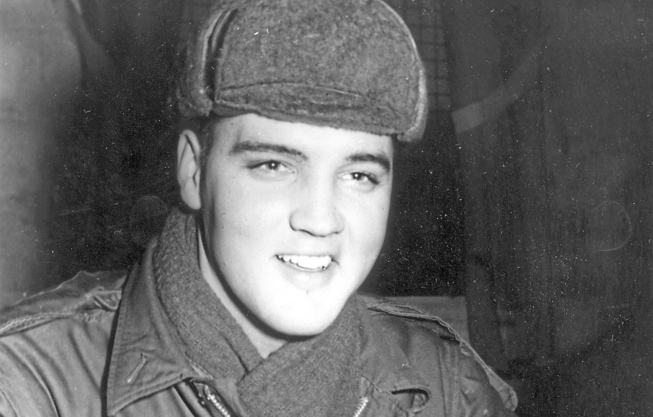 17th December 1958:  US rock 'n' roll singer Elvis Presley (1935 - 1977) in military uniform during his stint as a US serviceman at the Grafenwoehr exercise camp, Germany.  (Keystone/Getty Images)