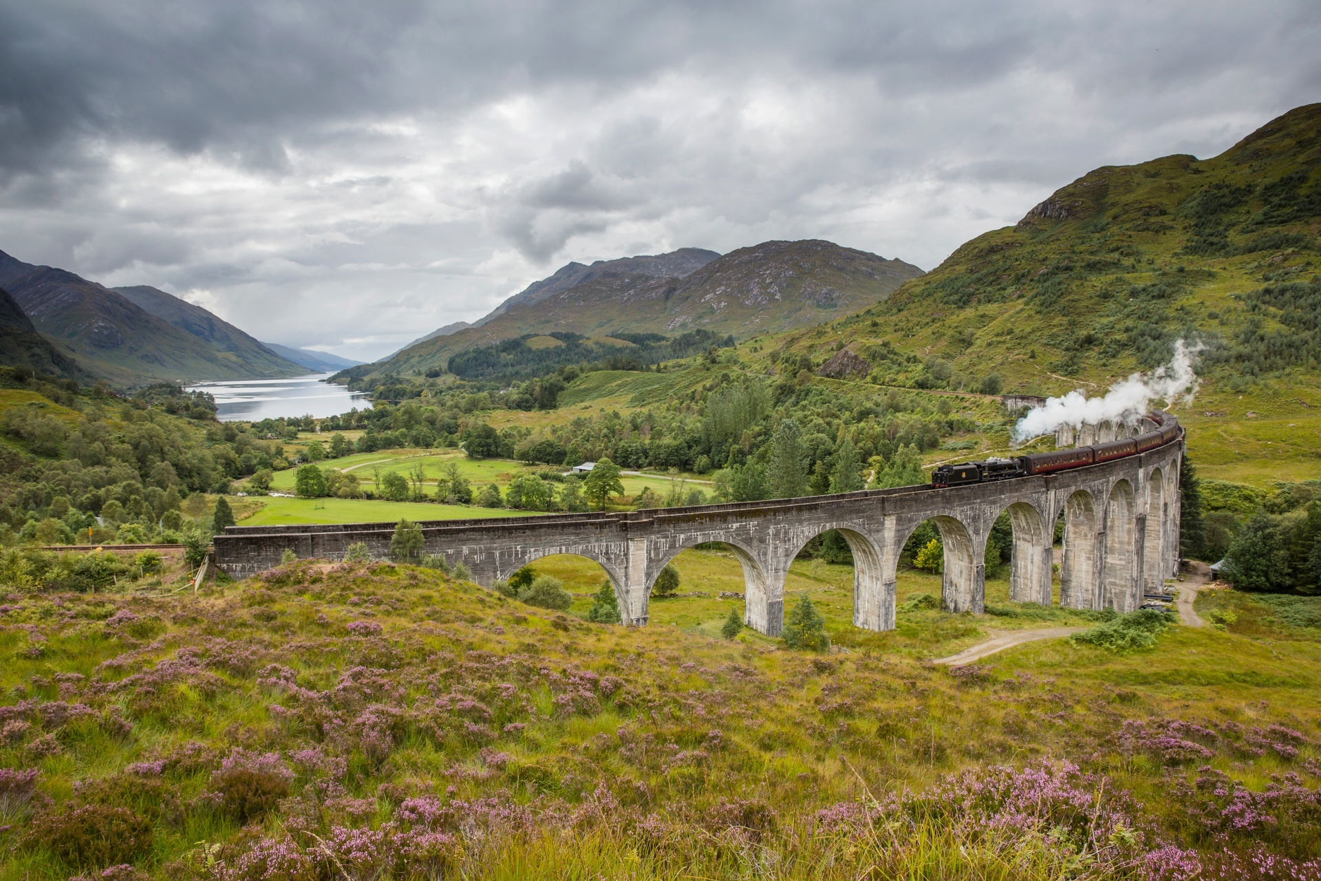 The Jacobite steam train passing over the Glenfinnan Viaduct at the head of Loch Shiel, Lochaber (Visit Scotland / Kenny Lam)
