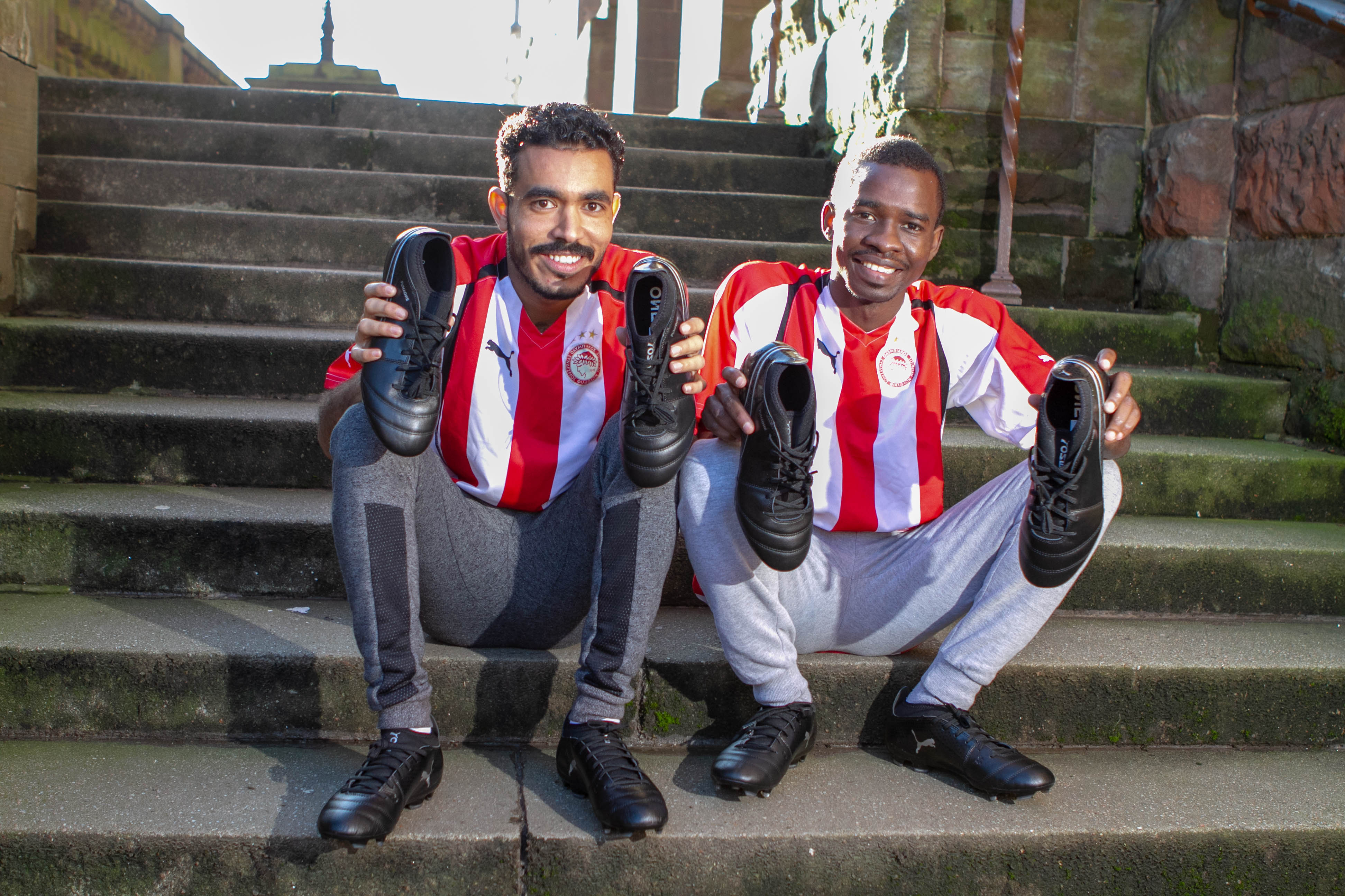Sudanese footballers Hassim and Tariq with their new boots at St Aloysius' Church in Glasgow (Chris Austin / DC Thomson)