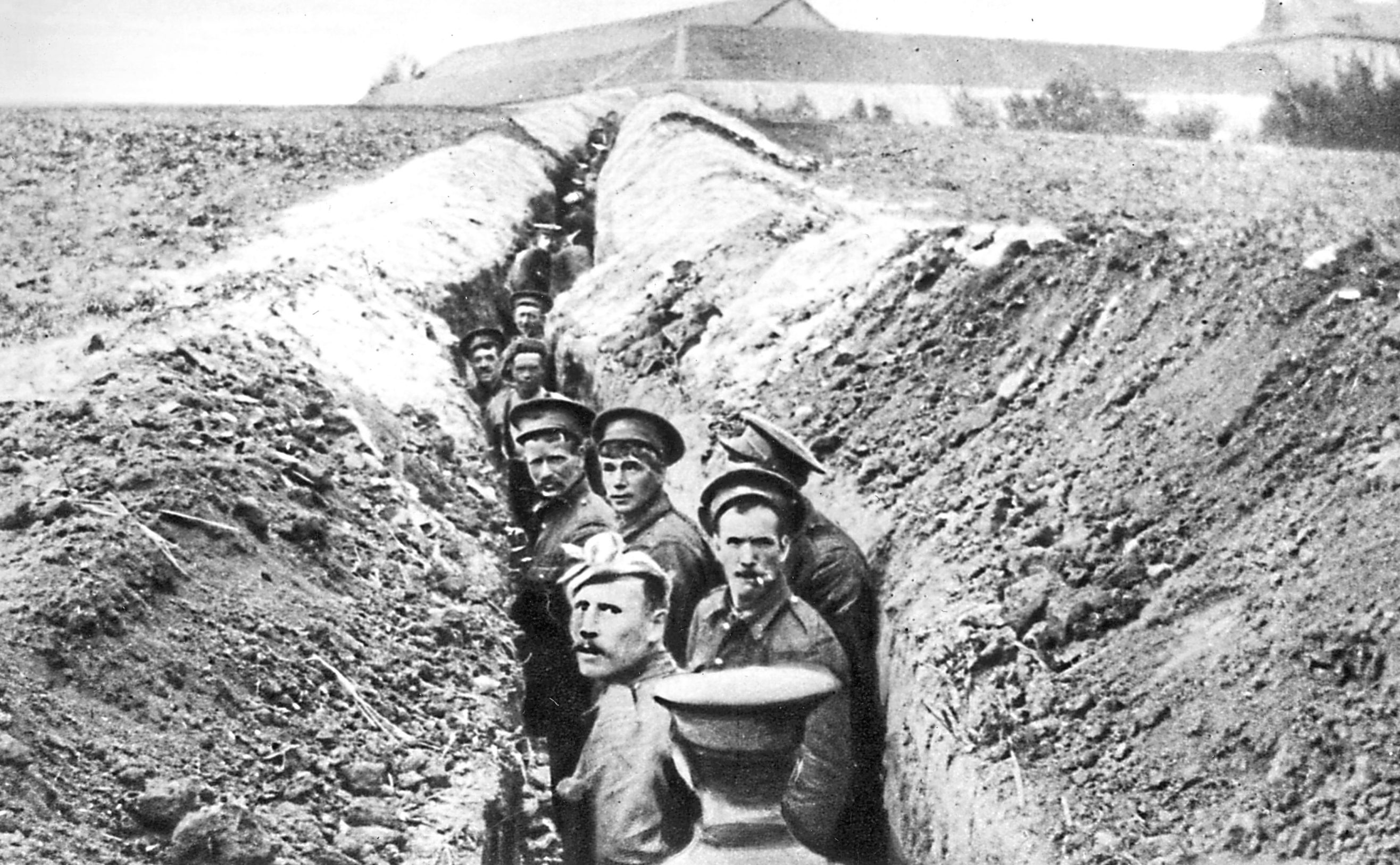 28th October 1914:  British soldiers lined up in a narrow trench during World War I.  (Hulton Archive/Getty Images)