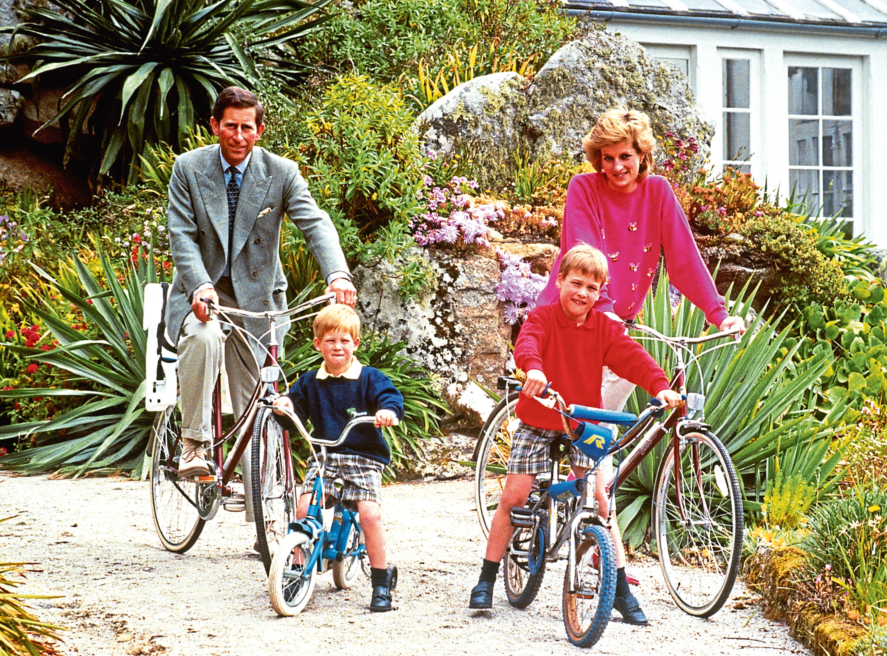 Charles and Diana with sons Harry and William prepare for a cycling trip in Tresco during a holiday in the Scilly Isles