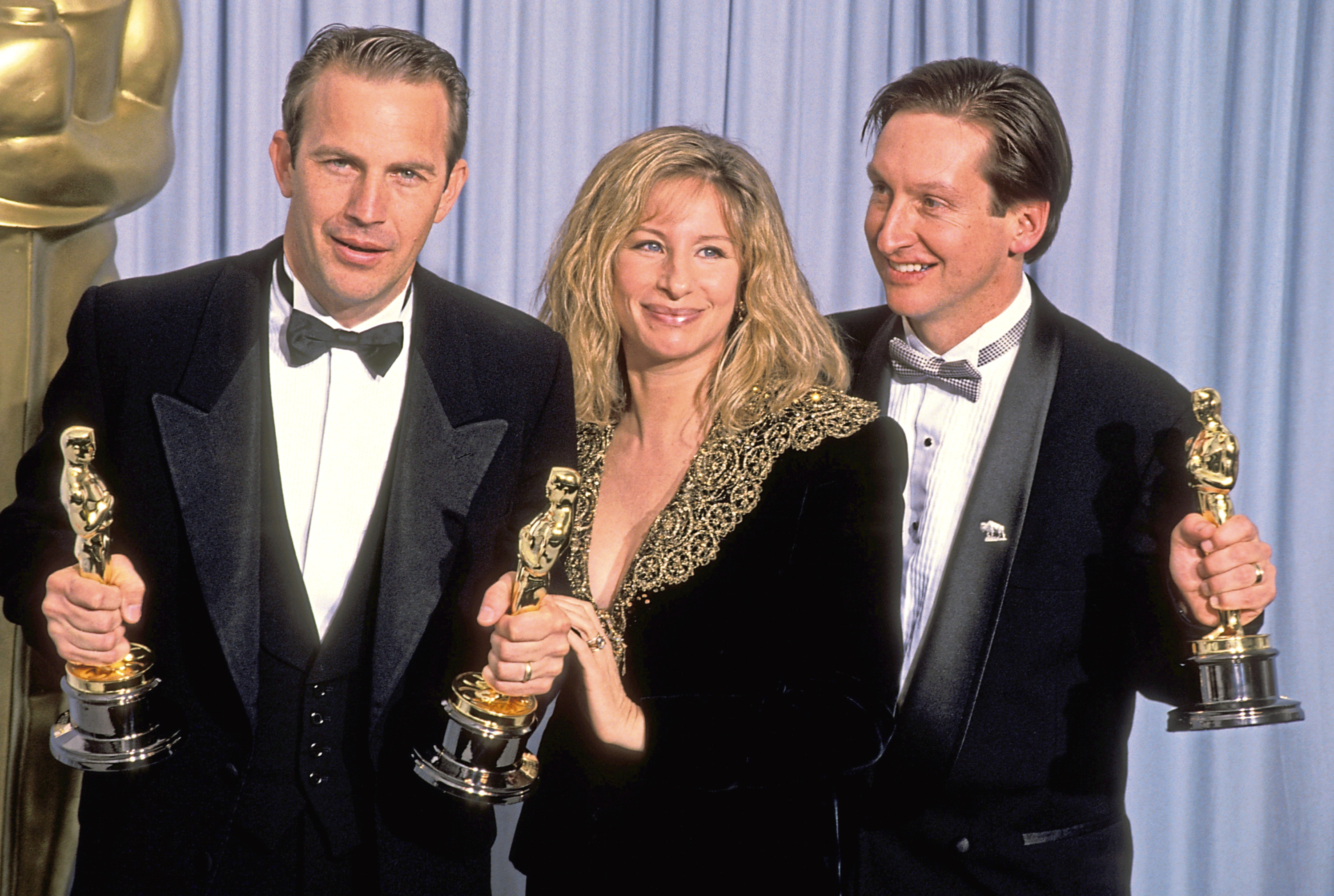 "Kevin Costner and Jim Wilson, winners Best Picture for ""Dances with Wolves,"" with Barbra Streisand, presenter (center) (Ron Galella/WireImage)"