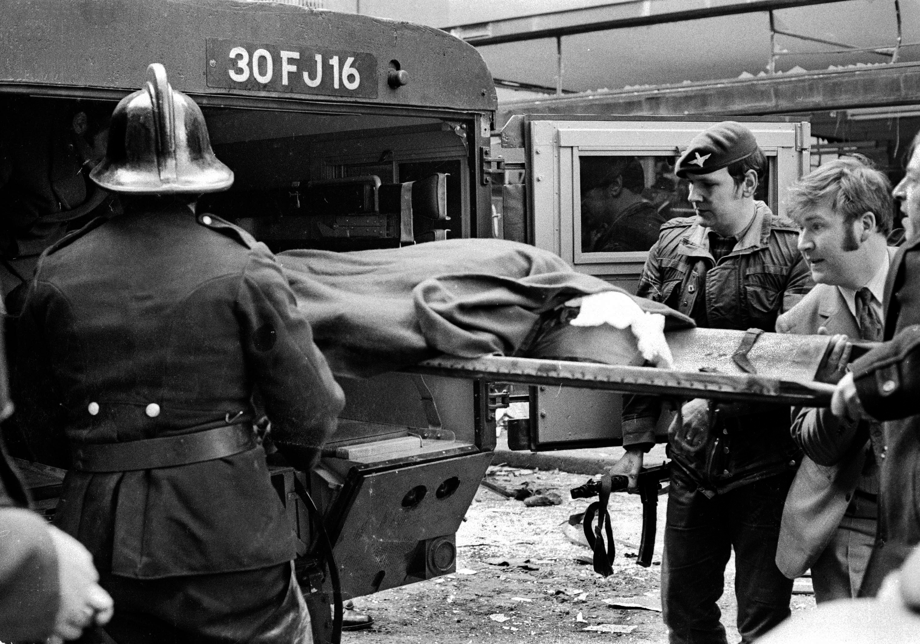 Explosion in Donegall Street, Belfast, in which 7 people died and 130 were injured. Four of the dead were bin men. No warning bomb was in a car. One of injured is taken away in a British Army ambulance. (Victor Patterson)