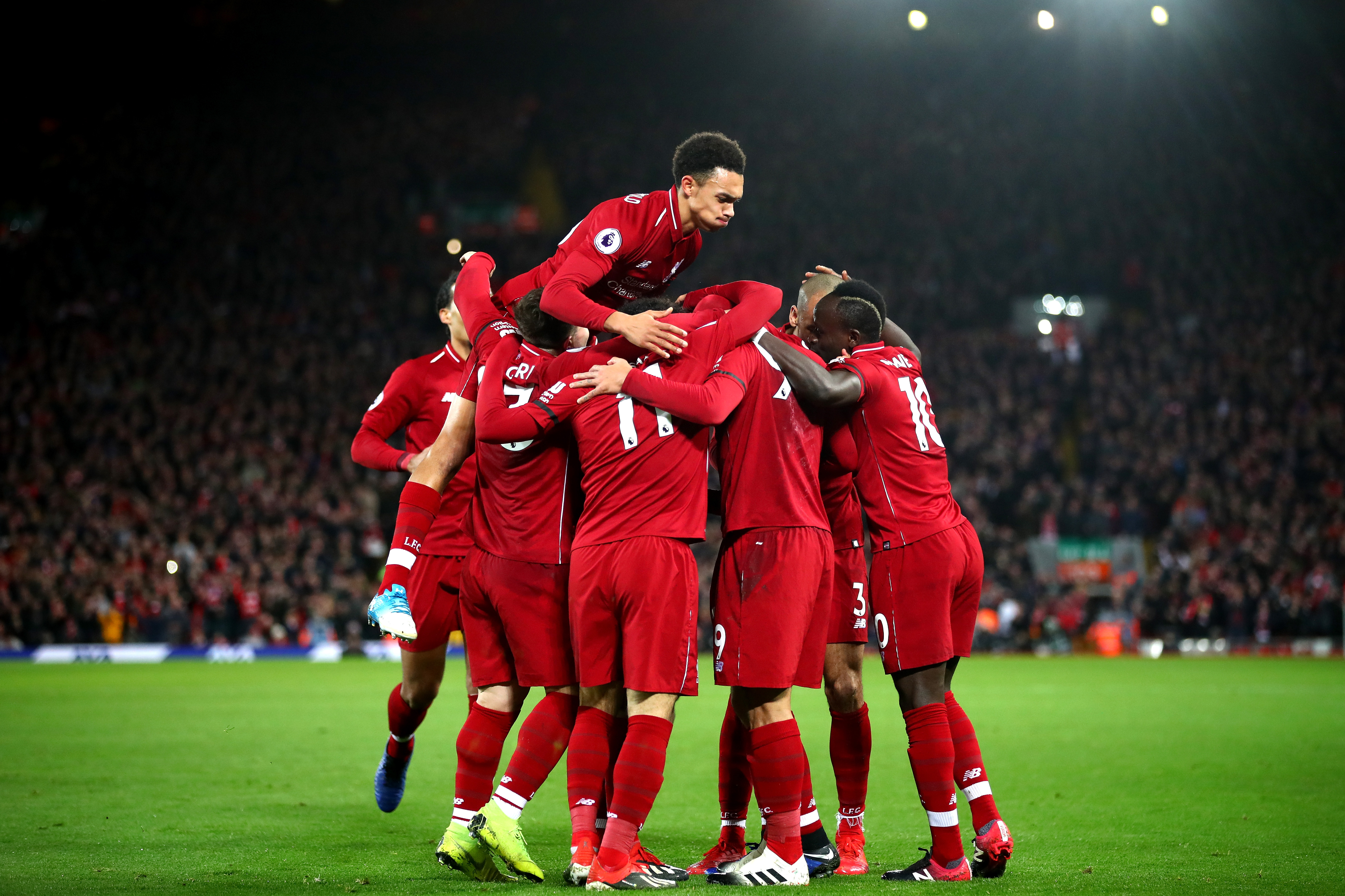 Liverpool players celebrate during their 5-1 win over Arsenal (Clive Brunskill/Getty Images)