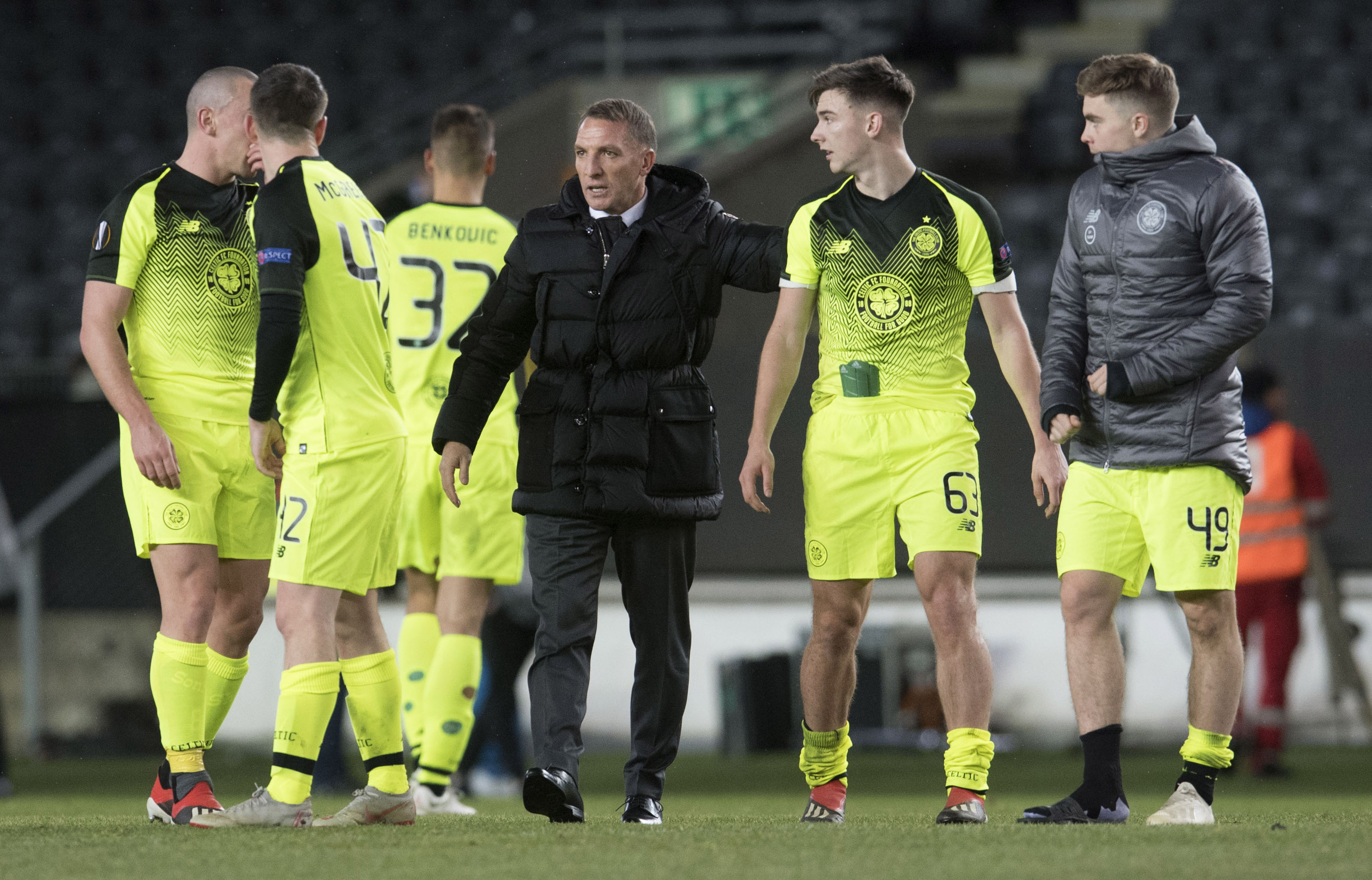 Celtic manager Brendan Rodgers celebrates with Kieran Tierney at full time.