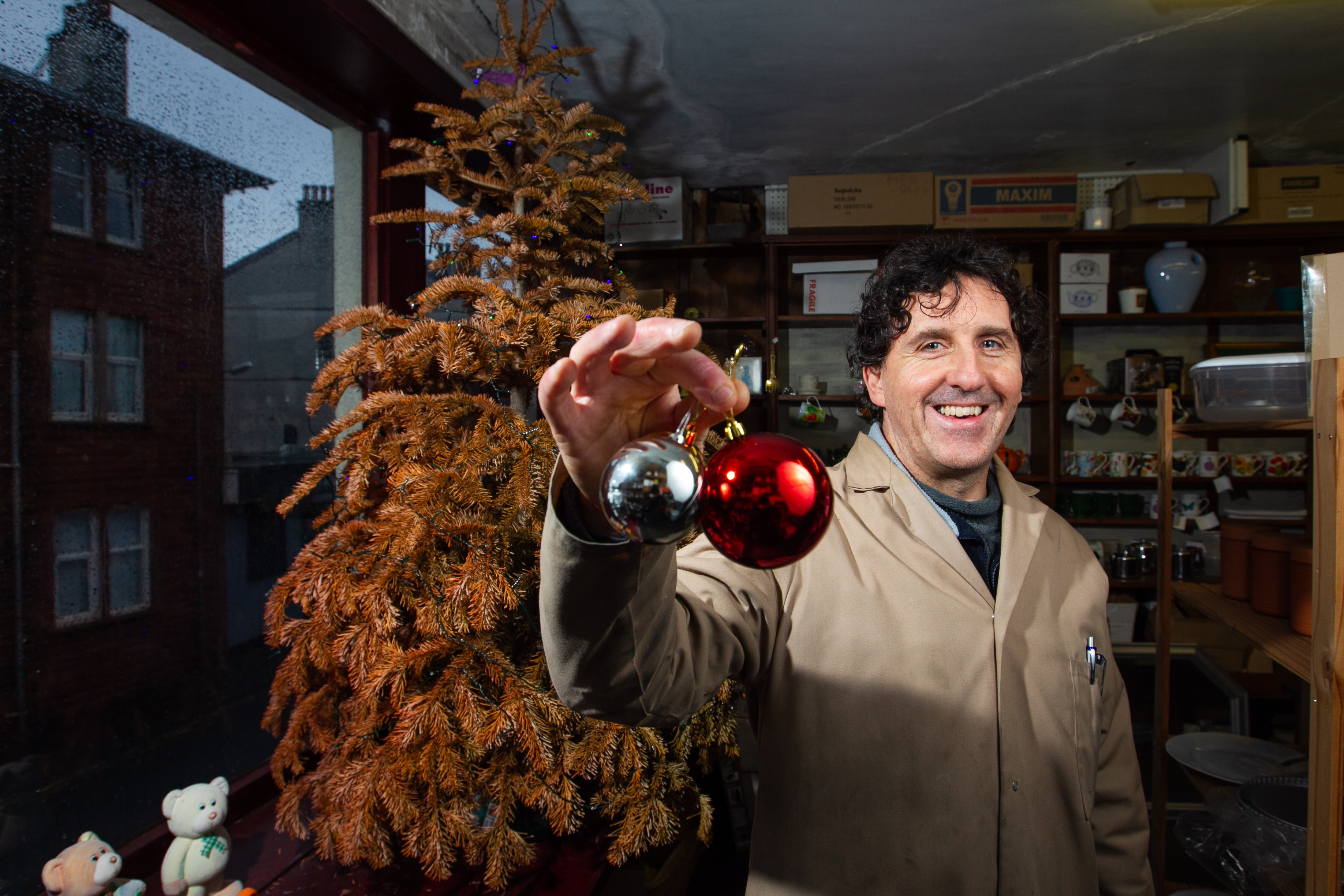 Hardware shop owner Paulo has had the same tree in his window for years to prove that the trees he was selling would last. He's proved his point two years later (Andrew Cawley / DC Thomson)