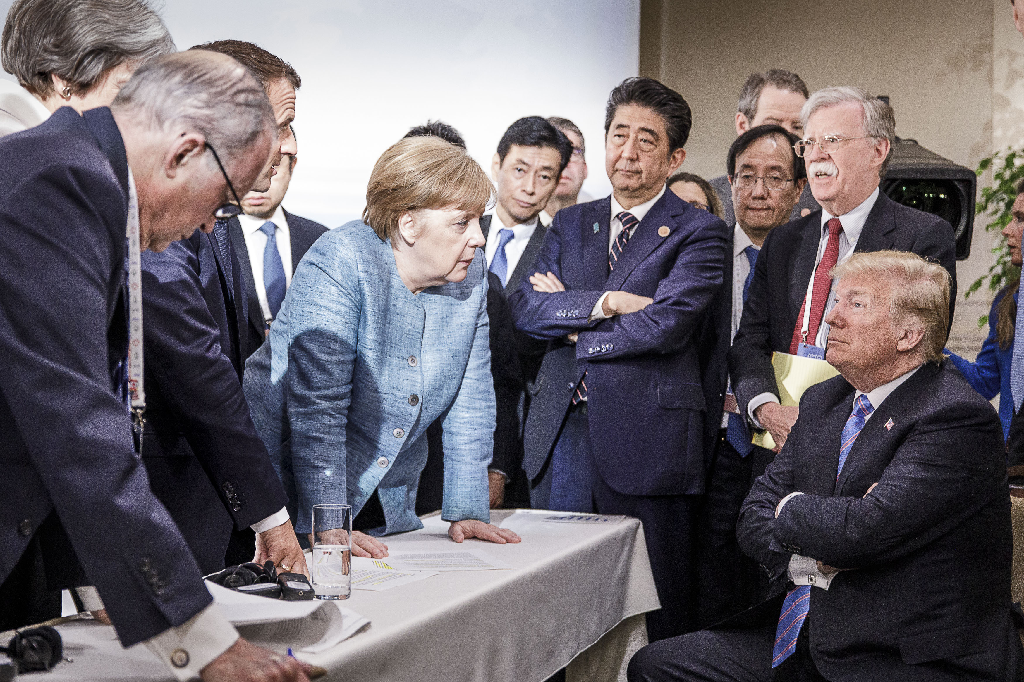 Angela Merkel and other world leaders try in vain to change the mind of Donald Trump at G7 summit in June (Jesco Denzel /Bundesregierung via Getty Images)