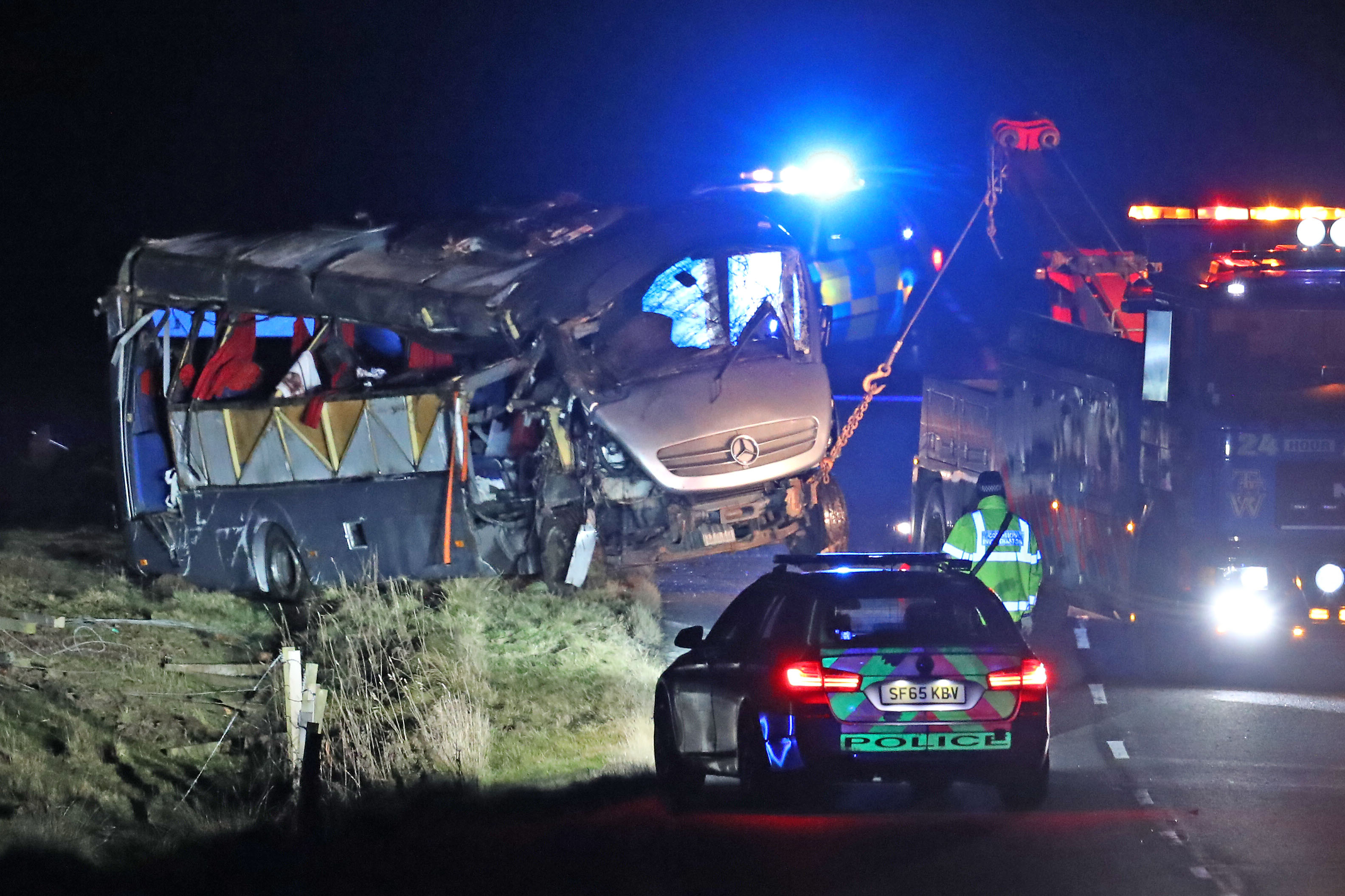 A minibus is pulled out of a field on the A6089, between Carfraemill and Gordon (Andrew Milligan/PA Wire)