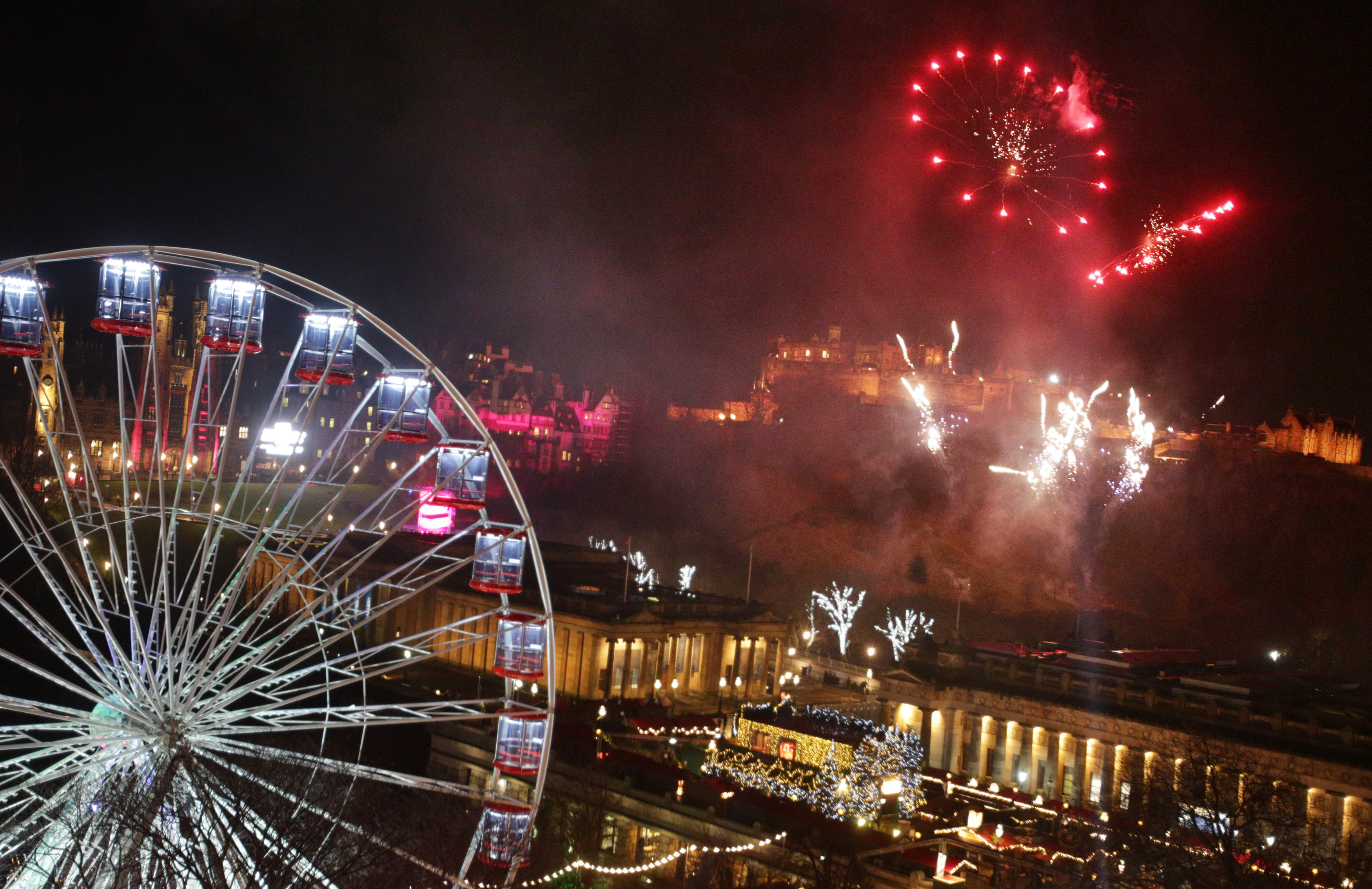 Fireworks light up the sky in Edinburgh last Hogmanay (David Cheskin/PA Wire)
