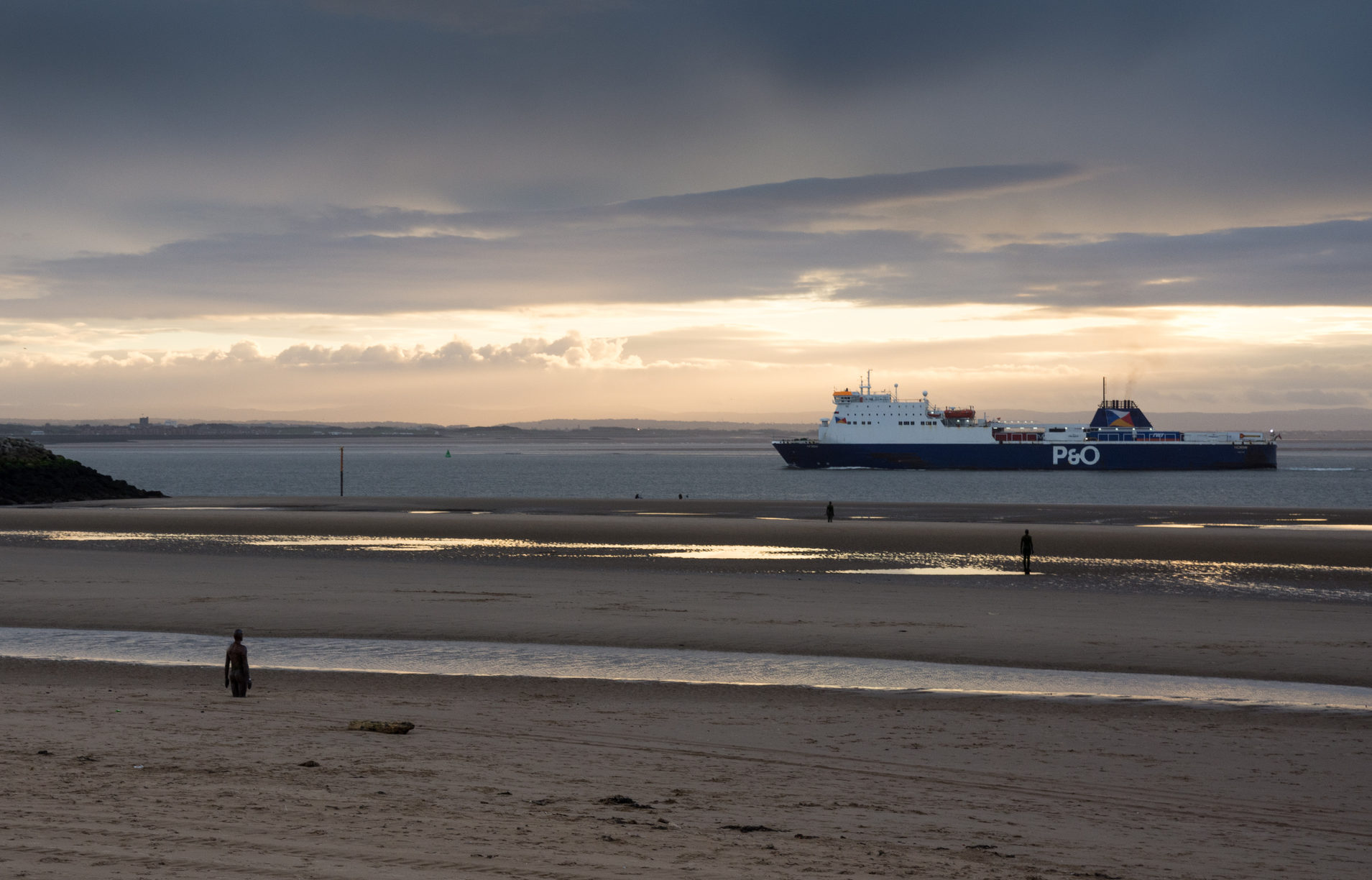 """A P&O Irish Sea ferry passes Antony Gormley's """"Another Place"""" sculptures on Crosby Beach on entry to the Port of Liverpool. (iStock)"""