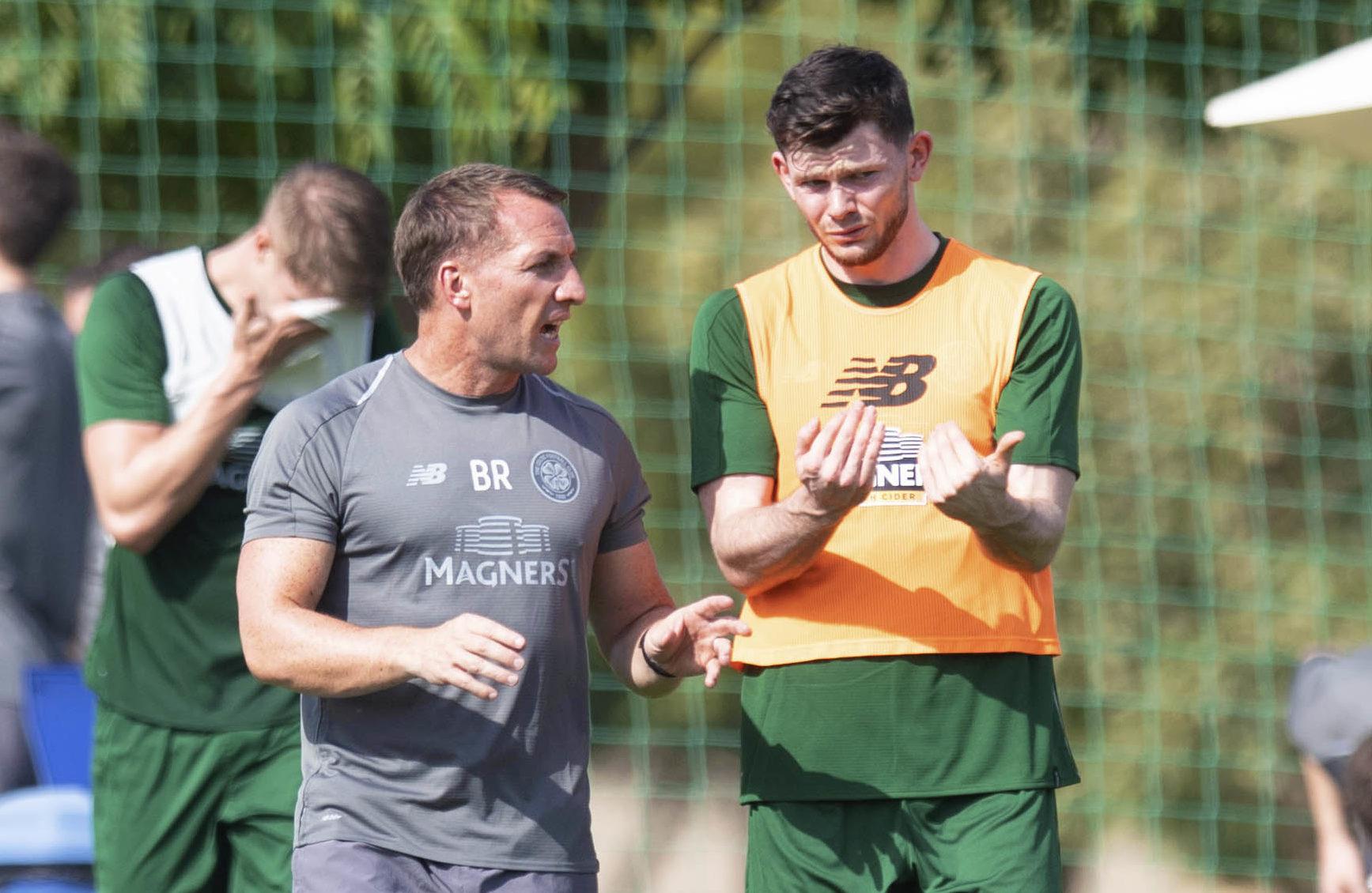 Celtic manager Brendan Rodgers (L) and Oliver Burke.