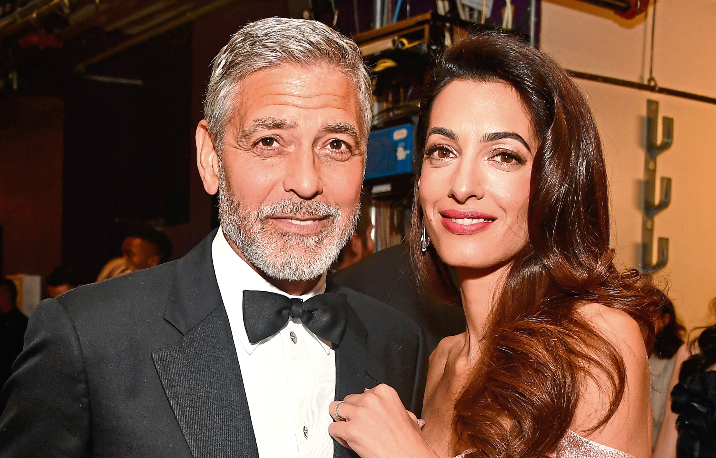 George Clooney (L) and Amal Clooney attend the American Film Institute's 46th Life Achievement Award Gala Tribute to George Clooney at Dolby Theatre in Hollywood, California.  (Frazer Harrison/Getty Images for Turner)