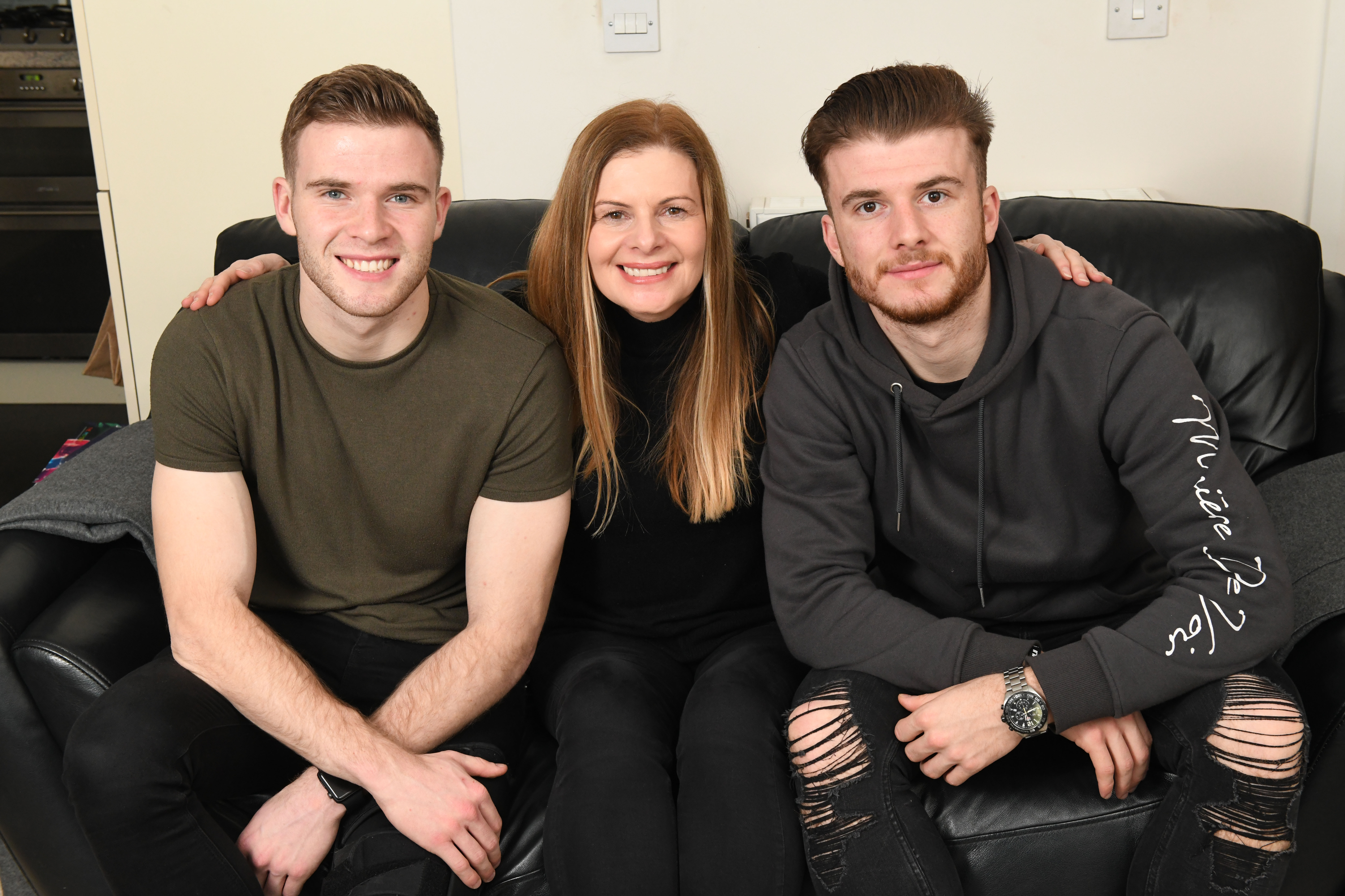 Avril Cadden with sons Chris (left) and Nicky (right) who both play in the Scottish Premiership (Paul Chappells)