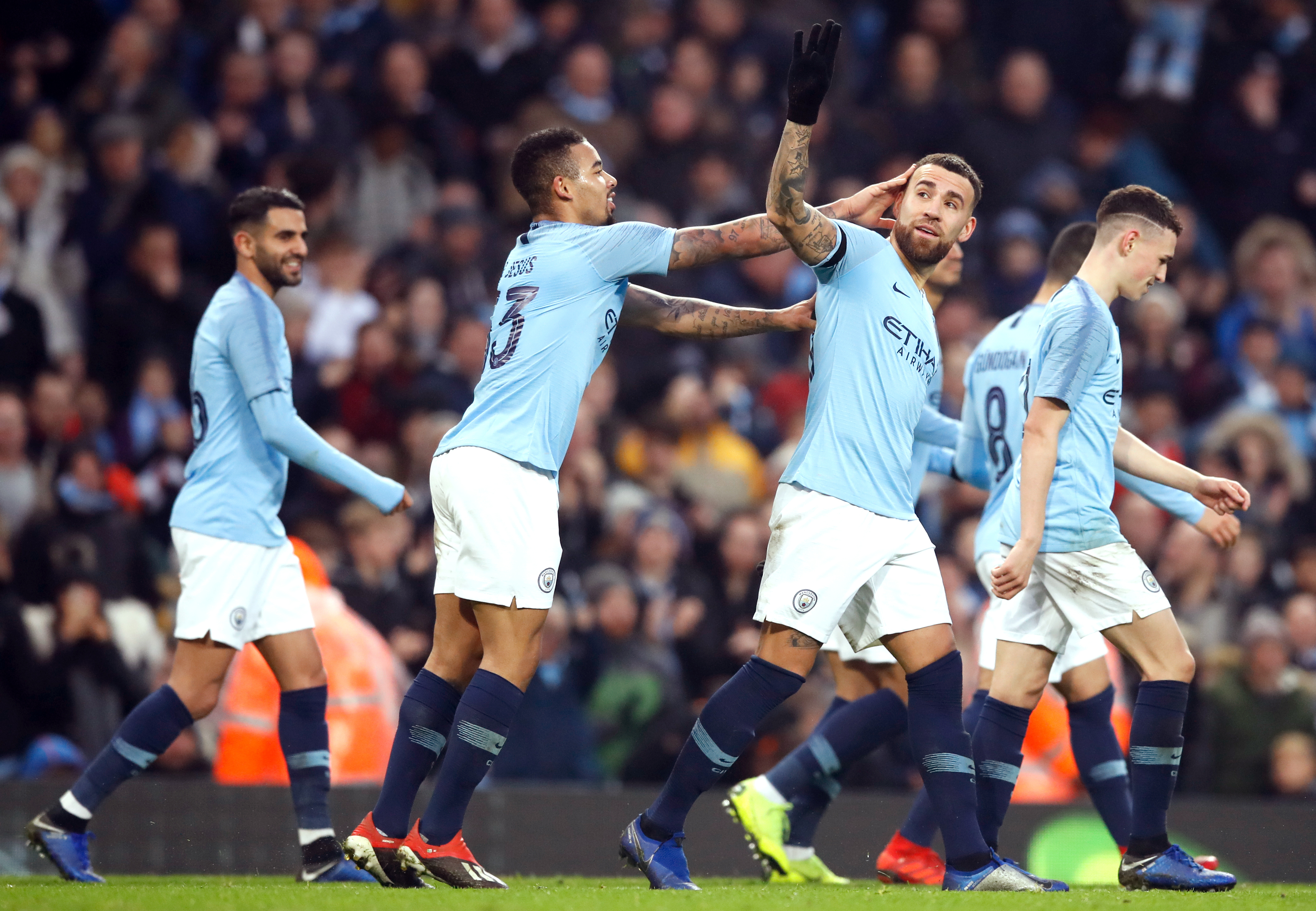 Manchester City's Nicolas Otamendi (second right) celebrates scoring his side's sixth goal of the game during the Emirates FA Cup, third round match at the Etihad Stadium, Manchester.
