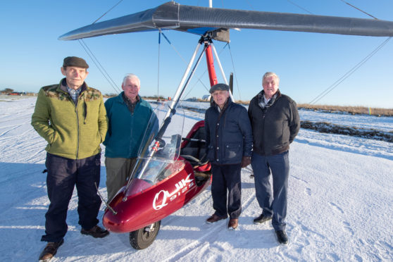 Pilots Jim Bolton, 78, Bob Shewan, 80, Alfie Thomson and Peter Bailey, both 81, with a microlight at Longside Airfield near Peterhead
