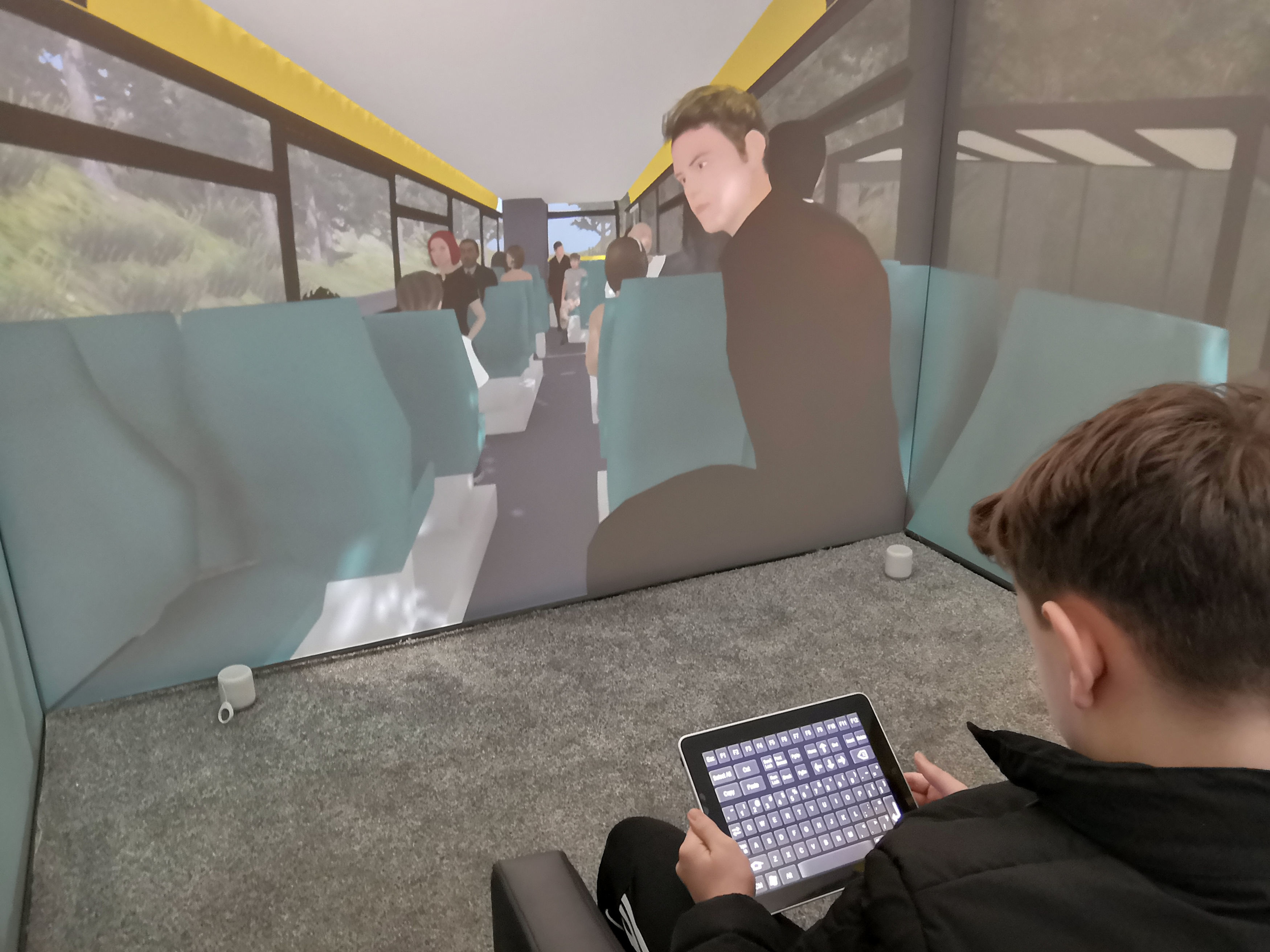 A child operating the Blue Room, a virtual reality suite that allows specialists to create a safe environment for children with autism to work their way through scenarios and confront their fears with the help of a therapist
