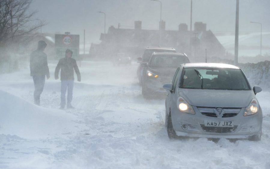 Motorists stuck in deep drifting snow on the A9 on the outskirts of Brora